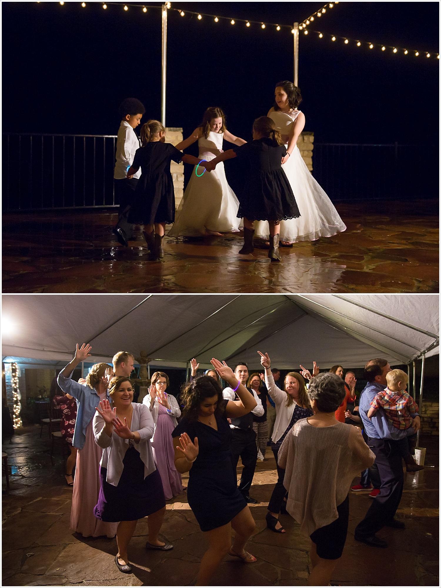 Children dance in the rain at wedding reception at La Rio Mansion
