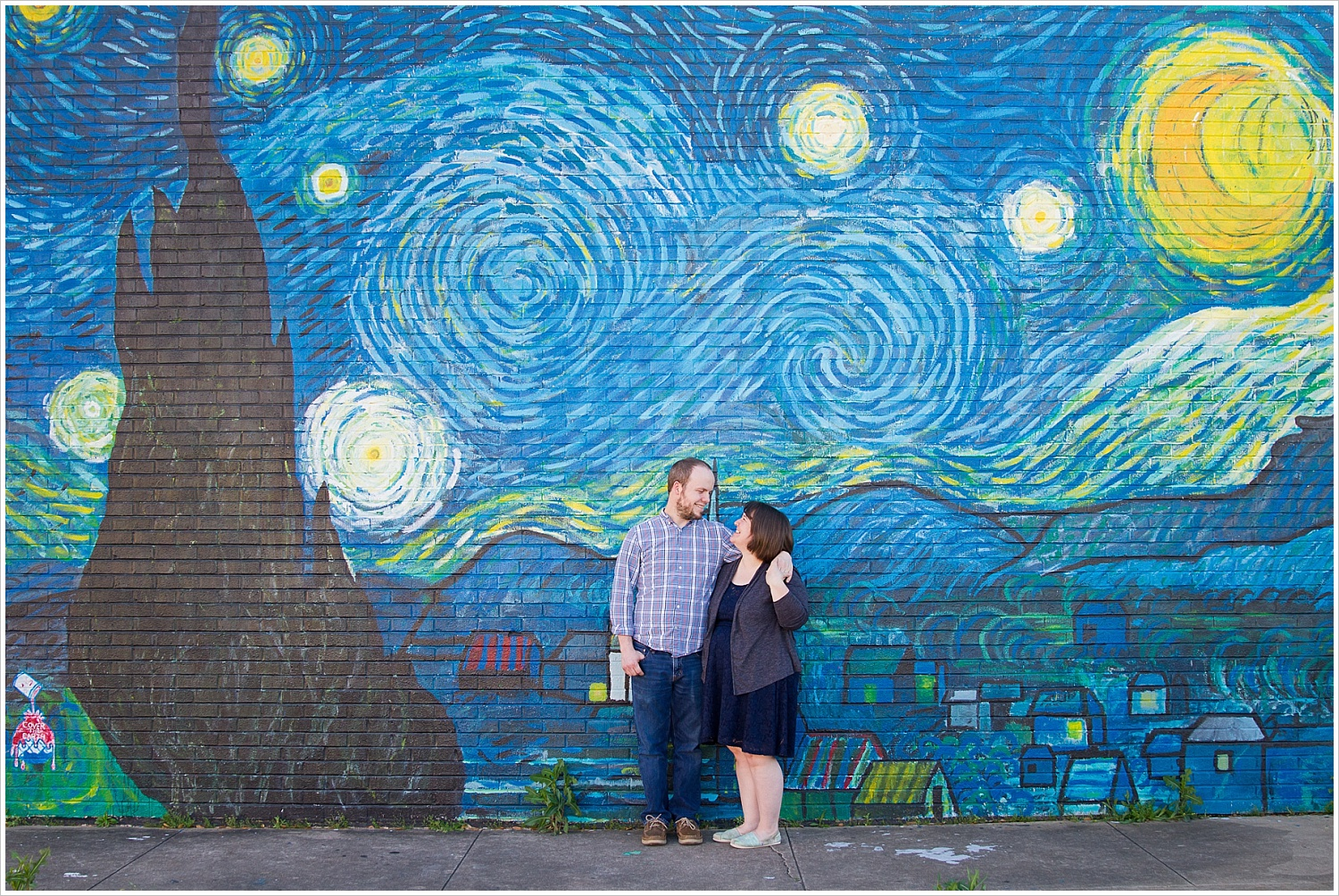 Couple poses in front of Starry Night wall mural in downtown Waco, Texas