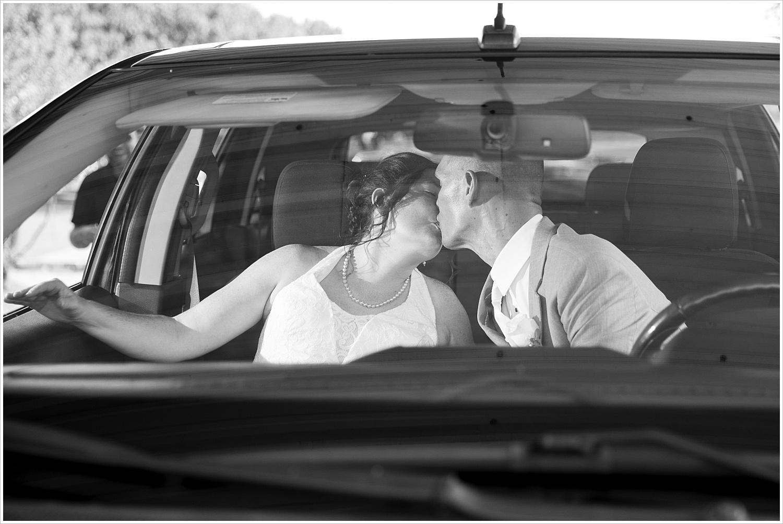 Bride and groom kiss as they leave their wedding reception at Central Presbyterian Church in Waco/Woodway, TX - Jason & Melaina Photography, www.jasonandmelaina.com