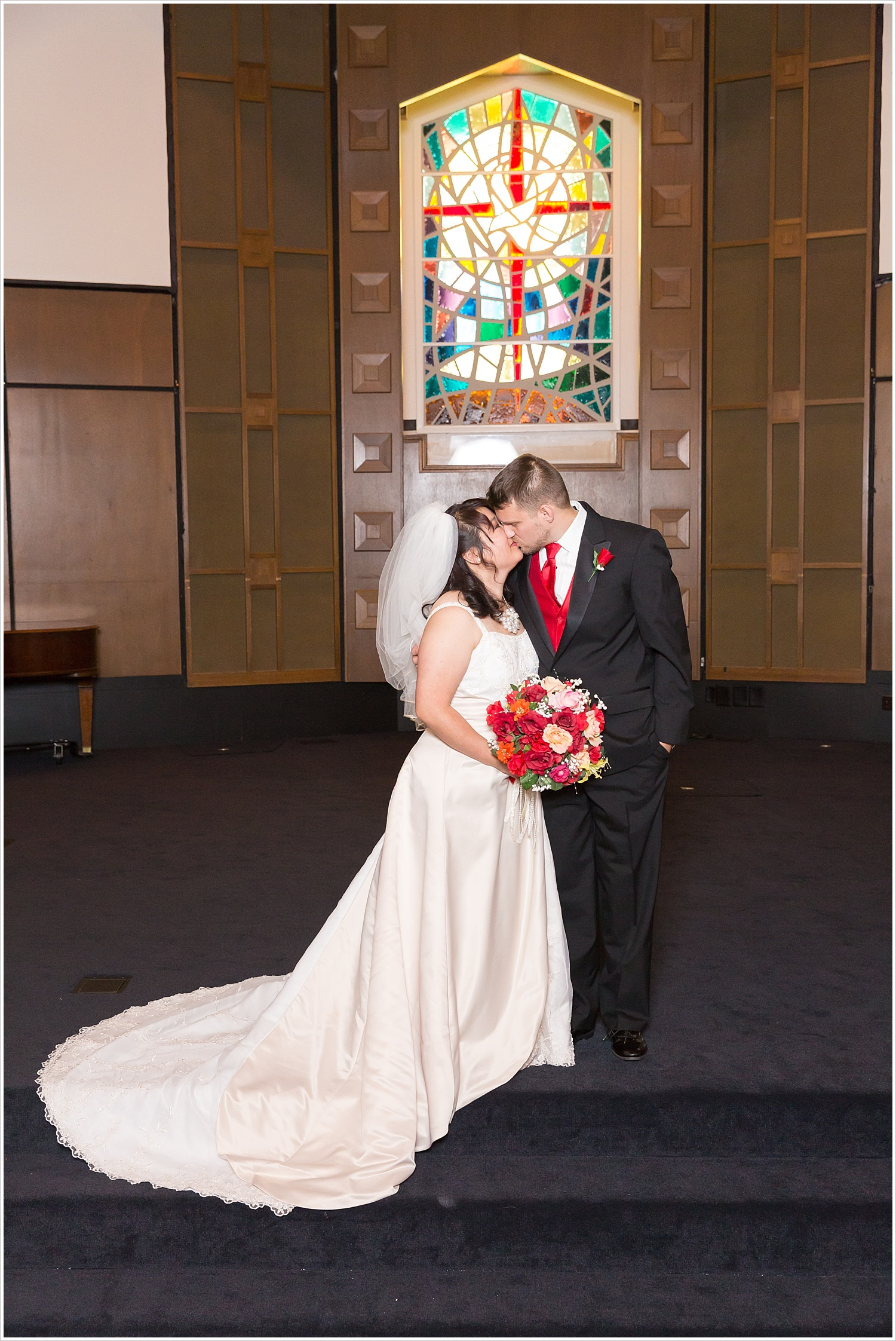 Bride and groom kiss in church chapel,Traditional Church wedding, Highland Baptist Church in Waco, Texas - Jason & Melaina Photography, www.jasonandmelaina.com