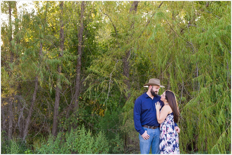 A bride looks up and smiles at her fiance during engagement photo session in Waco, Texas, Jason & Melaina Photography - www.jasonandmelaina.com