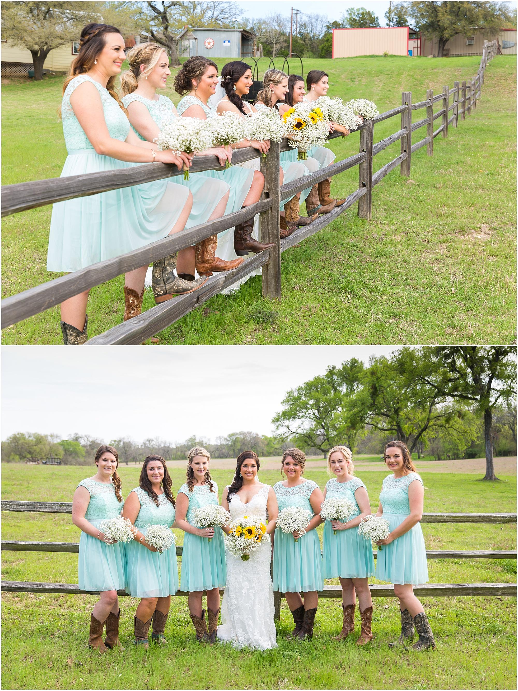 Bride and bridesmaids pose along wooden fence - Jason & Melaina Photography
