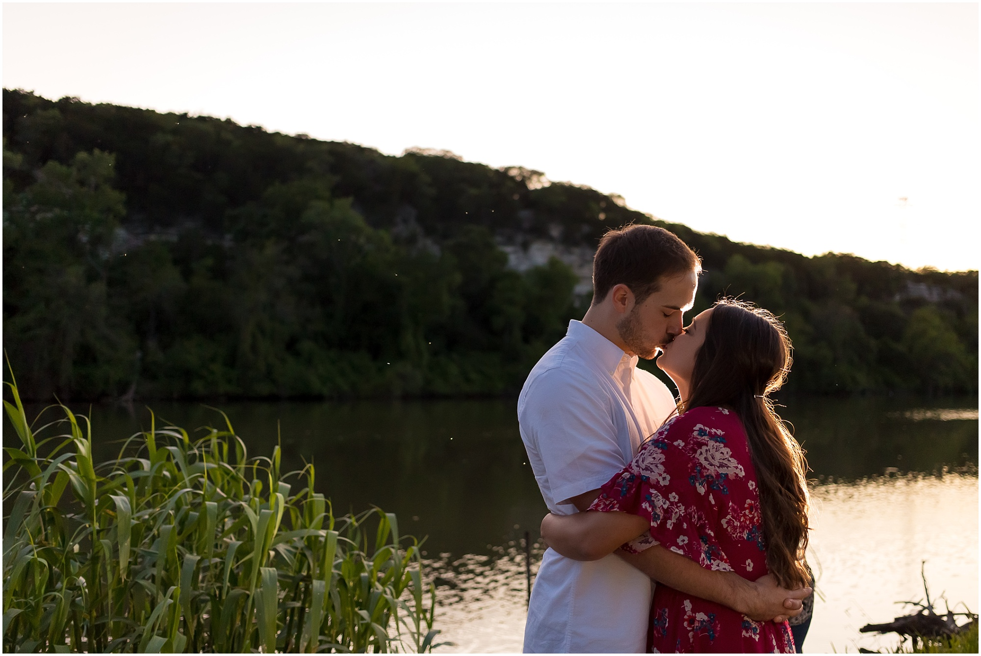 A couple kisses as the sun sets over the Bosque River during their engagement session - Waco, Texas - Jason & Melaina Photography - www.jasonandmelaina.com