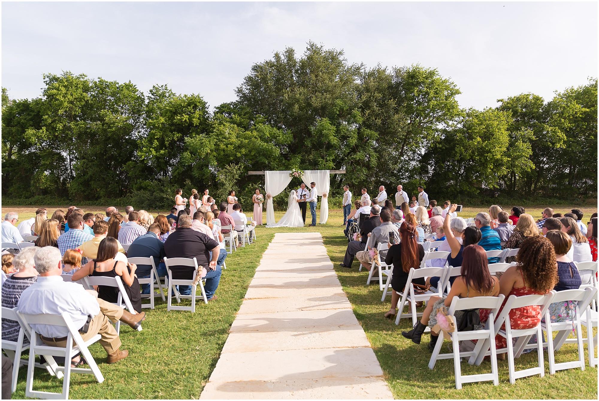 Ceremony site during an outdoor summer wedding at Rustic Acres in Belton, Texas - Jason & Melaina Photography - www.jasonandmelaina.com