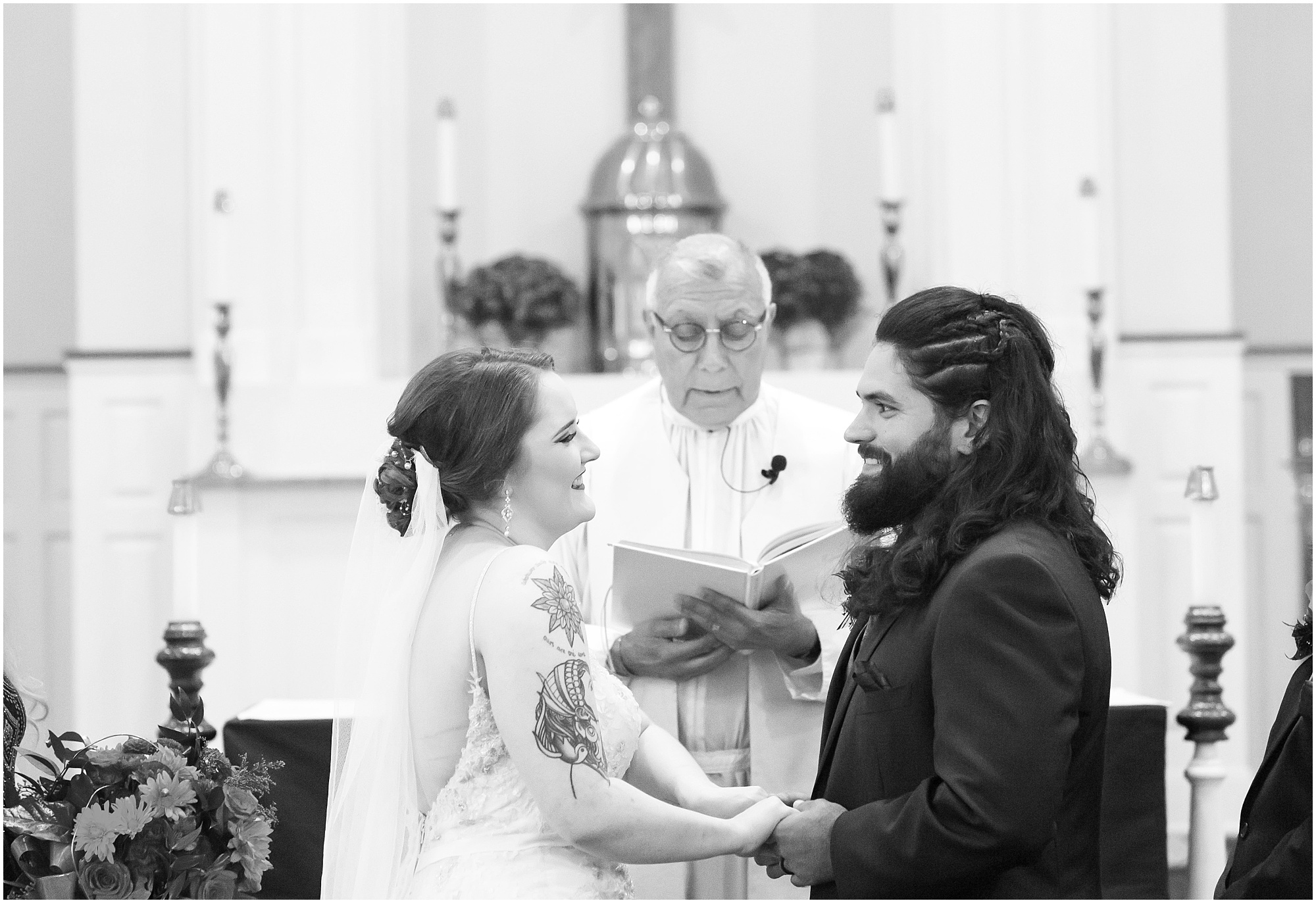 Groom and bride smile at one another after exchanging vows, black and white image - Jason & Melaina Photography - http://jasonandmelaina.com