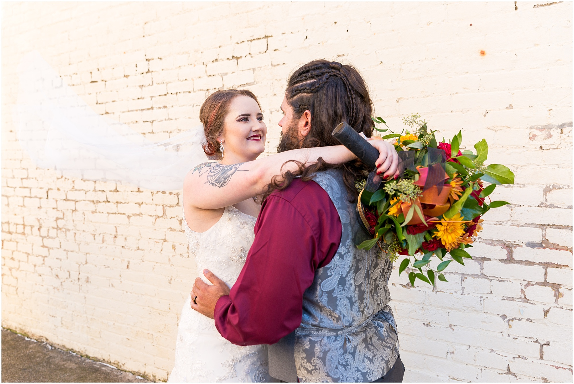 Bride smiles at groom outside wedding reception - Jason & Melaina Photography - http://jasonandmelaina.com