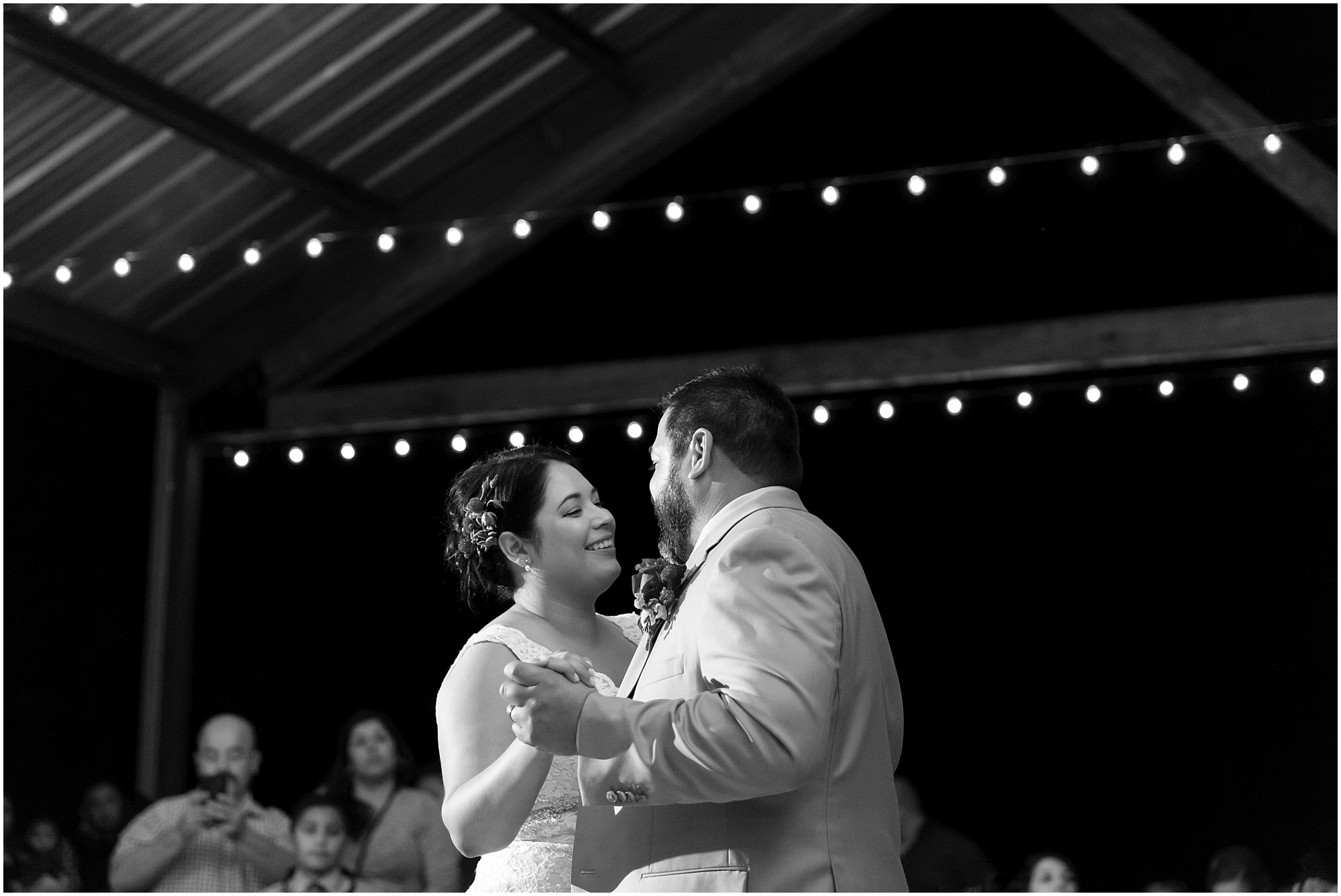 Bride & Groom dance under string lights during their wedding reception - Dove Creek Ranch in Dublin, Texas - Jason & Melaina Photography - www.jasonandmelaina.com