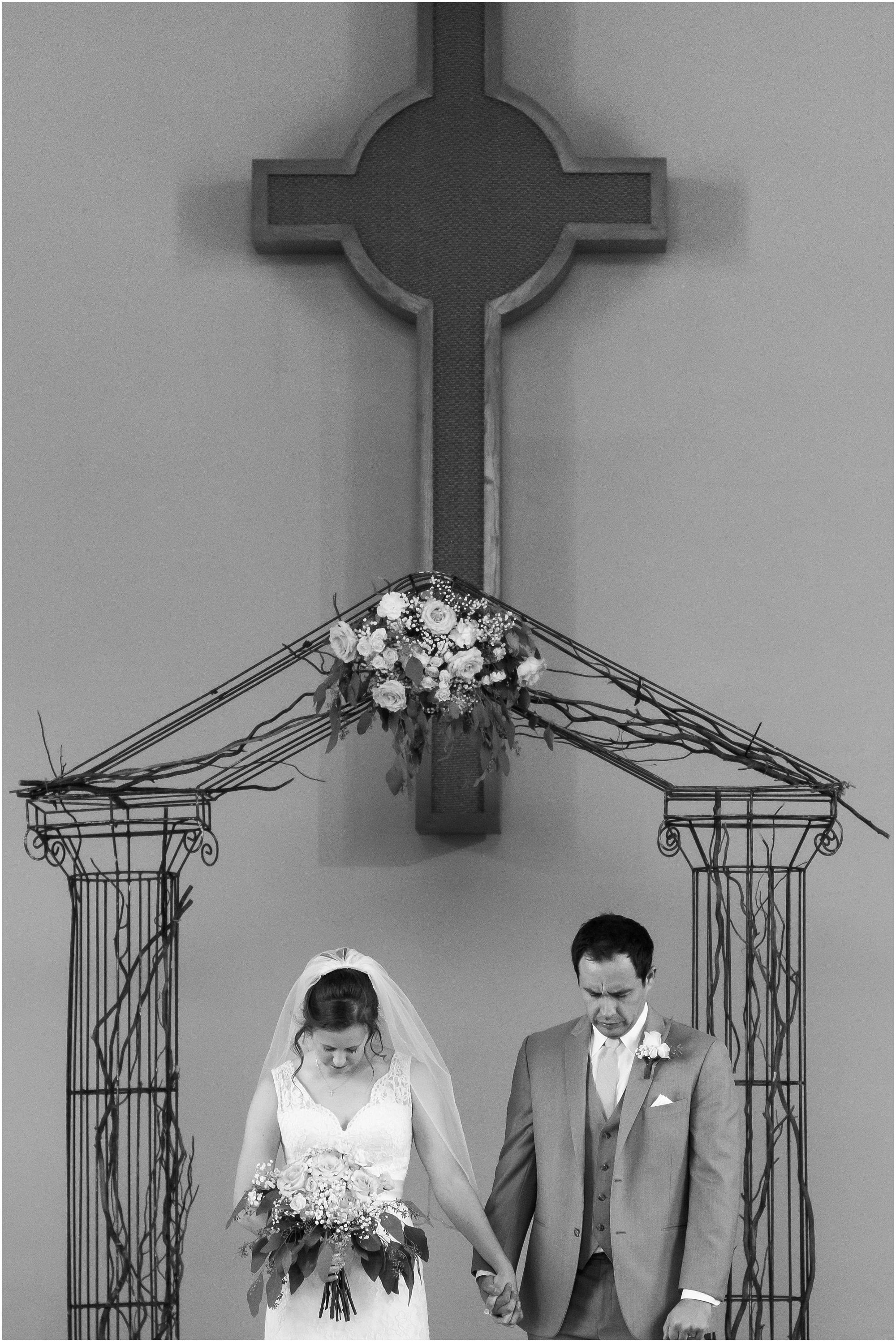 Bride and groom praying at the altar - Jason & Melaina Photography - www.jasonandmelaina.com