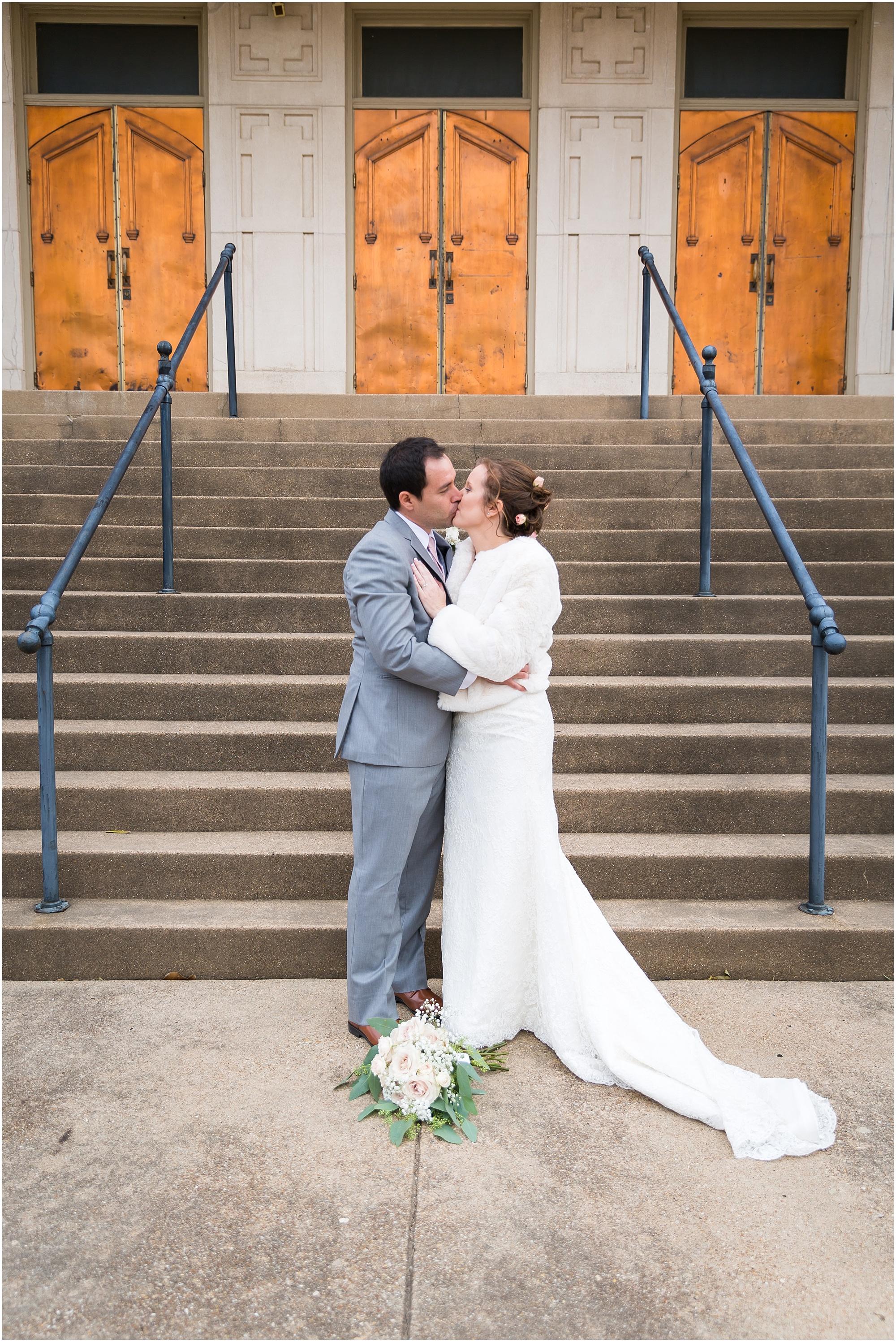 Bride and groom kiss in front of the doors at The Chapel at Meyer Center in Waco, Texas - Jason & Melaina Photography - www.jasonandmelaina.com
