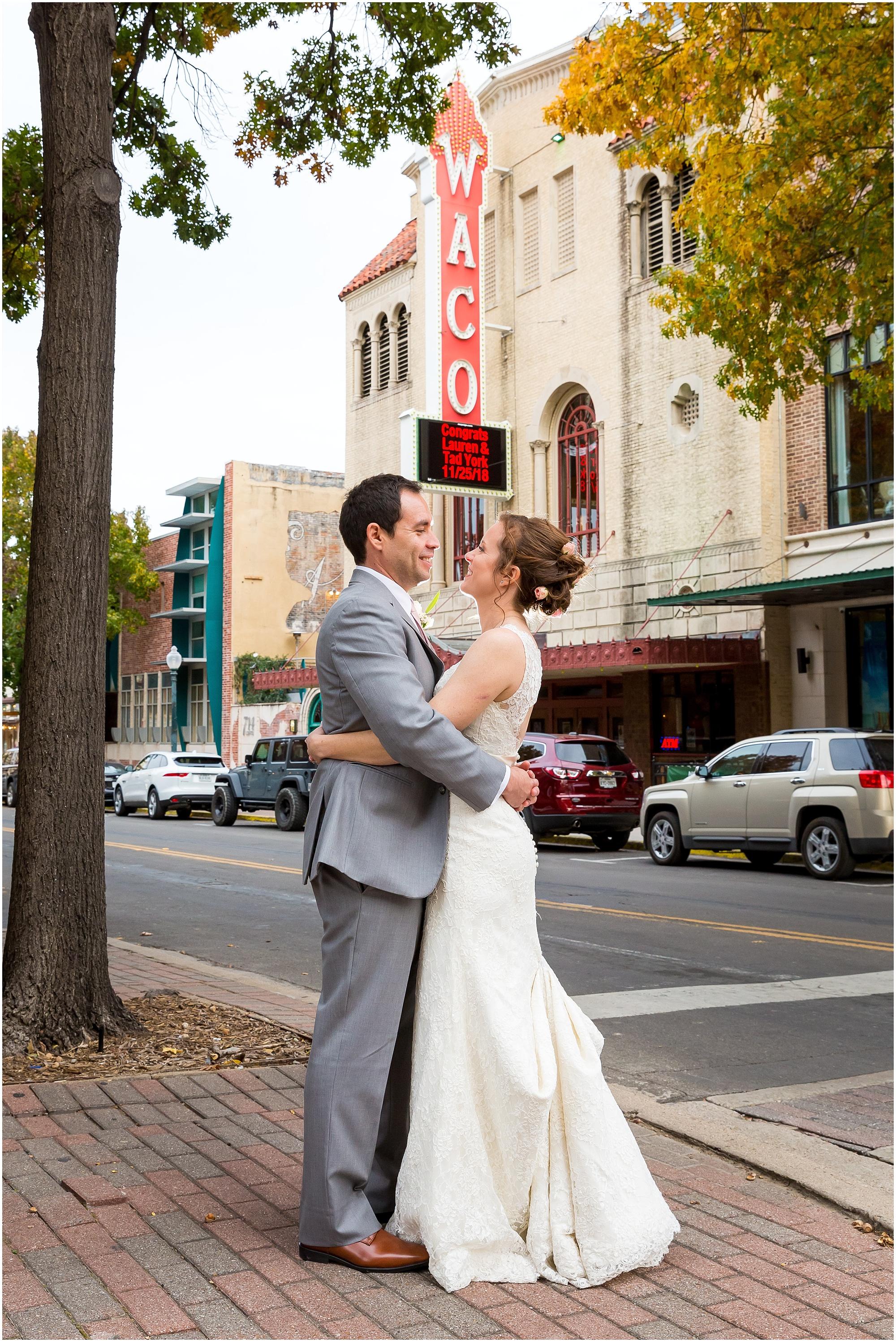 Bride and groom with their names on the Hippodrome Marquee in Waco, Texas - Jason & Melaina Photography - www.jasonandmelaina.com