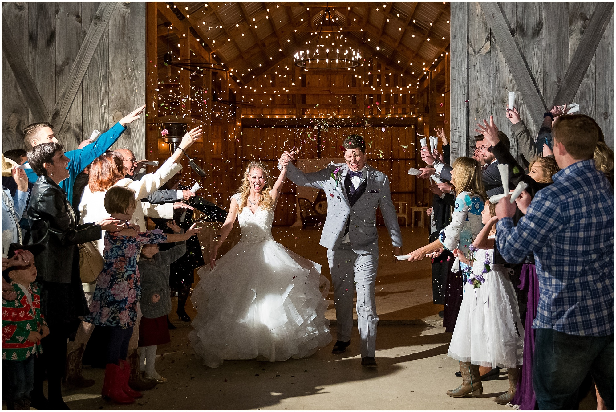 Bride and groom leave their reception with a wildflower toss - Disney-inspired wedding at The Barn at 5 S Ranch - Jason & Melaina Photography - www.jasonandmelaina.com
