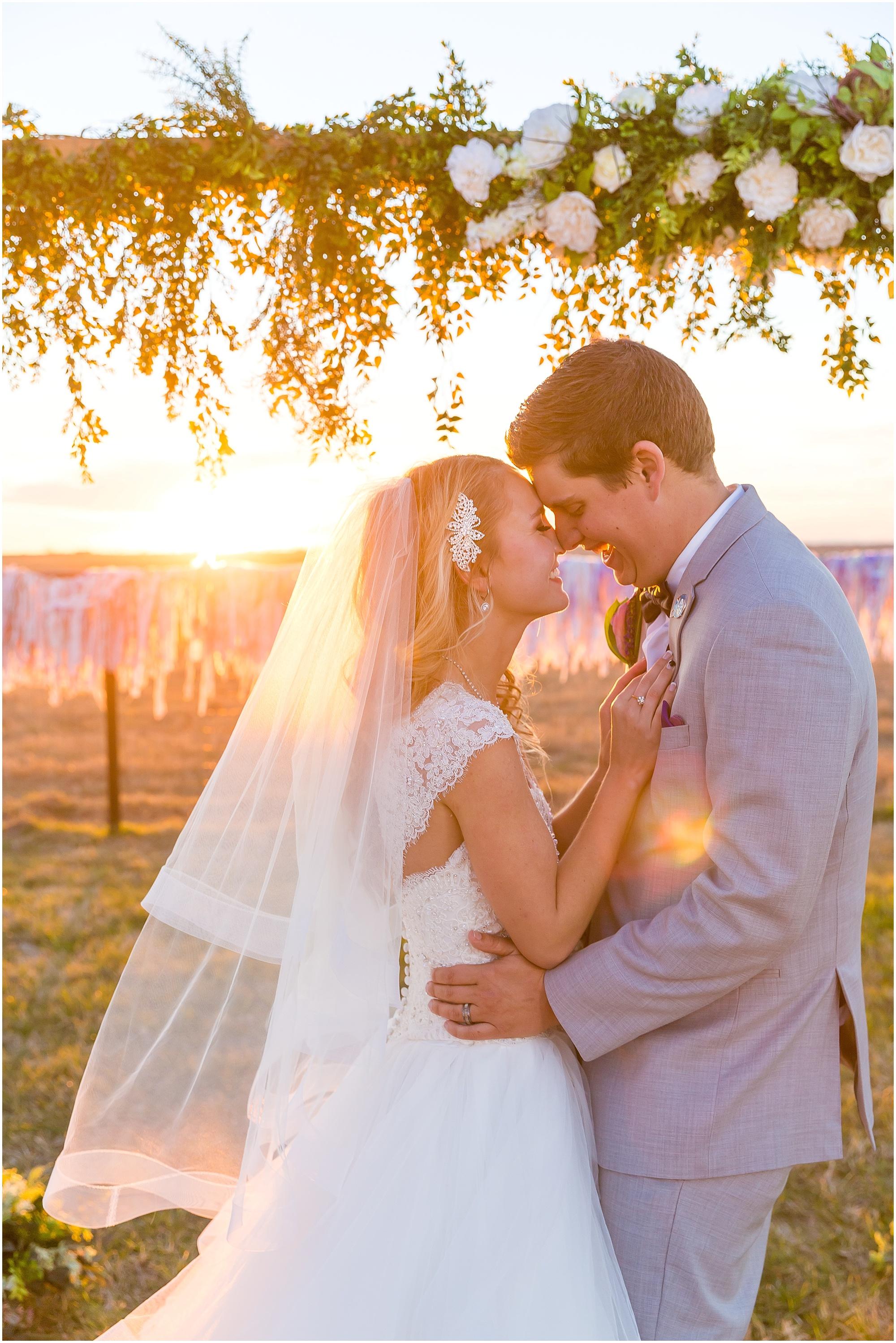 Bride and groom laugh together in the sunset light of golden hour - Jason & Melaina Photography - www.jasonandmelaina.com
