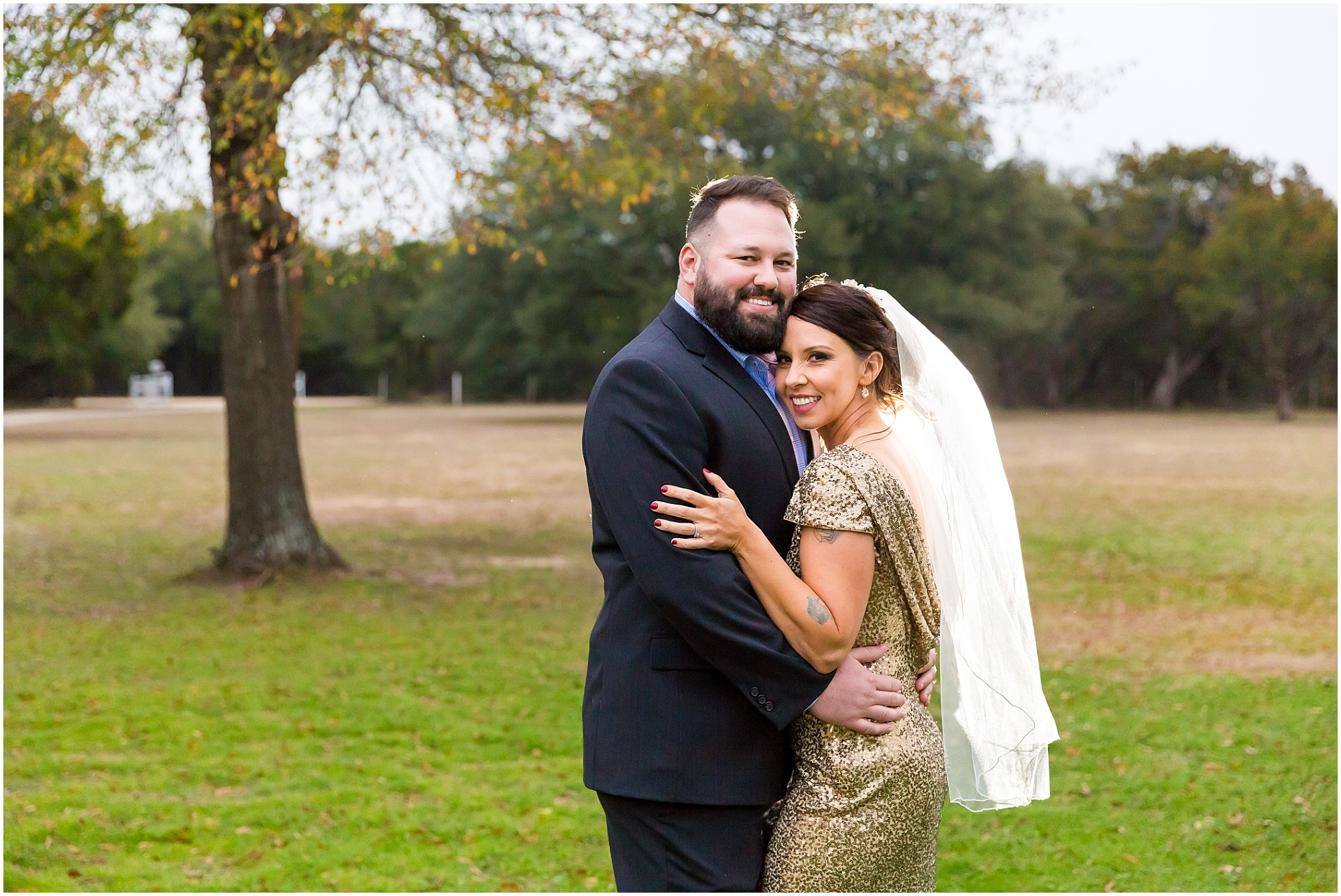 Couple holds one another and smiles at camera after their elopement at a private residence in Waco, Texas - Jason & Melaina Photography - www.jasonandmelaina.com