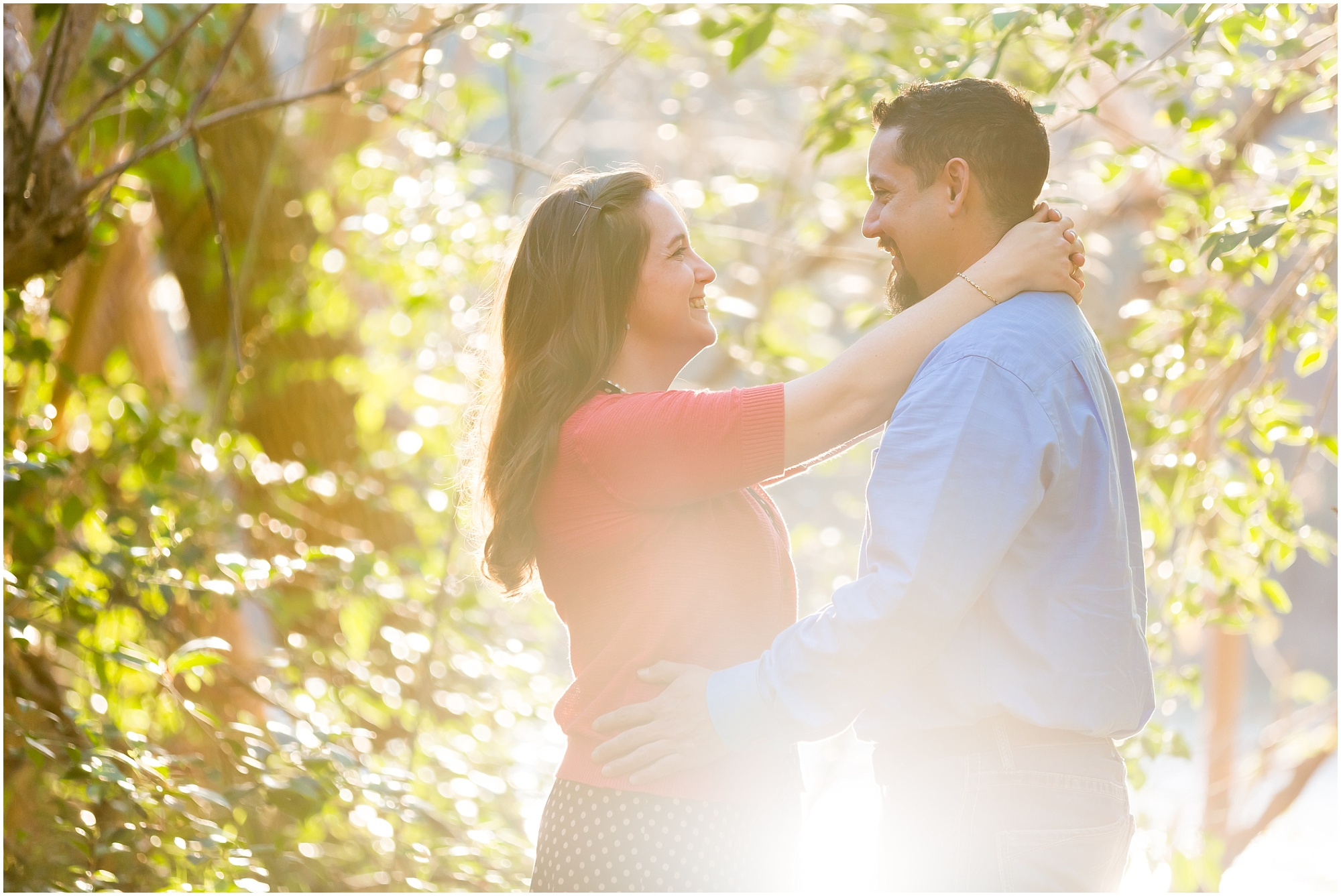 A couple laughs and hugs in the sunlight by the Brazos River in Waco, Texas - Jason & Melaina Photography - www.jasonandmelaina.com