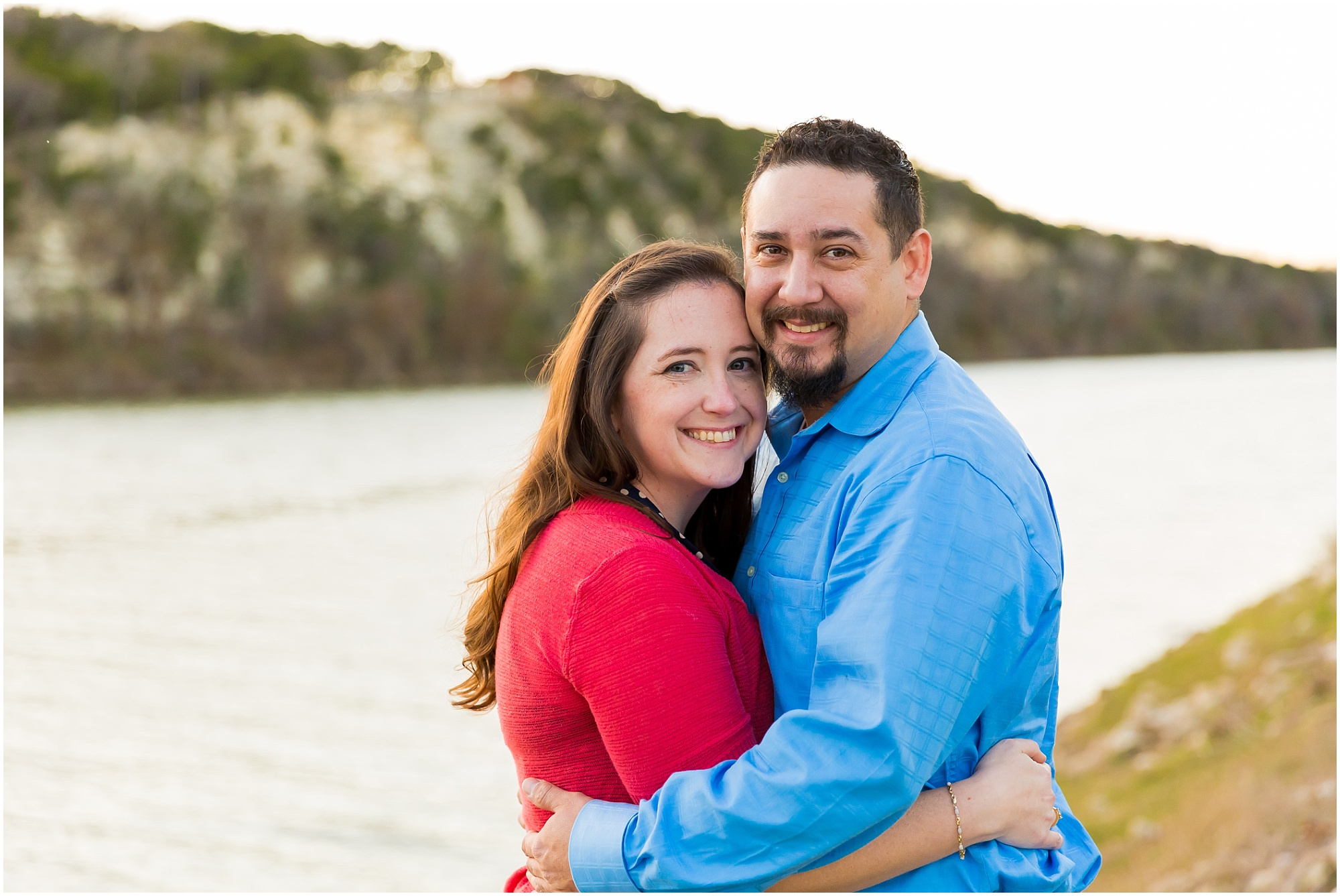 A couple smiles at the camera during their engagement photos in Cameron Park, Waco, Texas - Jason & Melaina Photography - www.jasonandmelaina.com