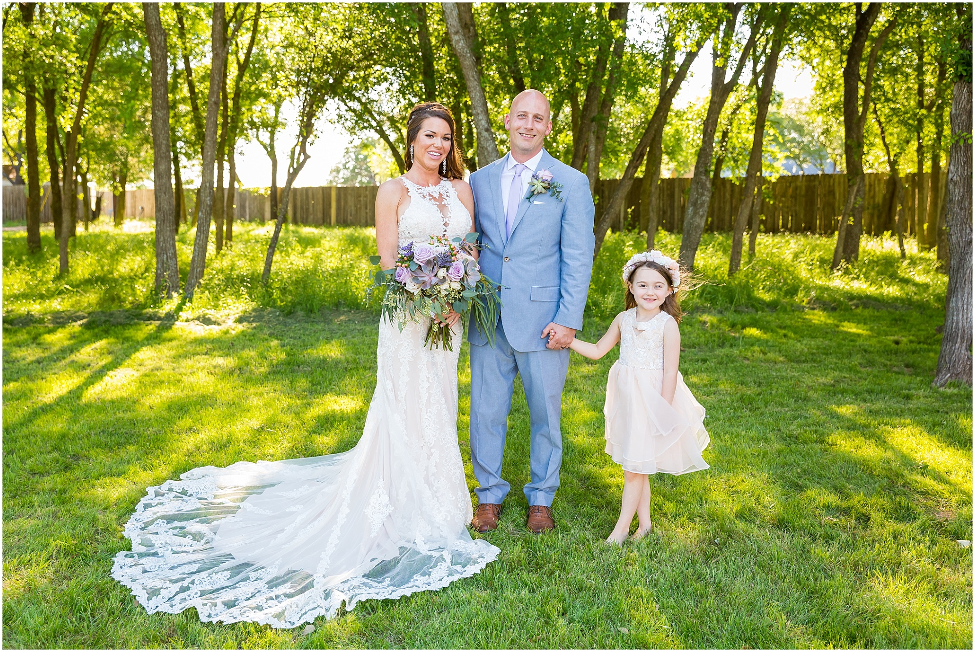 A bride and groom have their daughter be their flower girl for their wedding day | Jason & Melaina Photography | www.jasonandmelaina.com