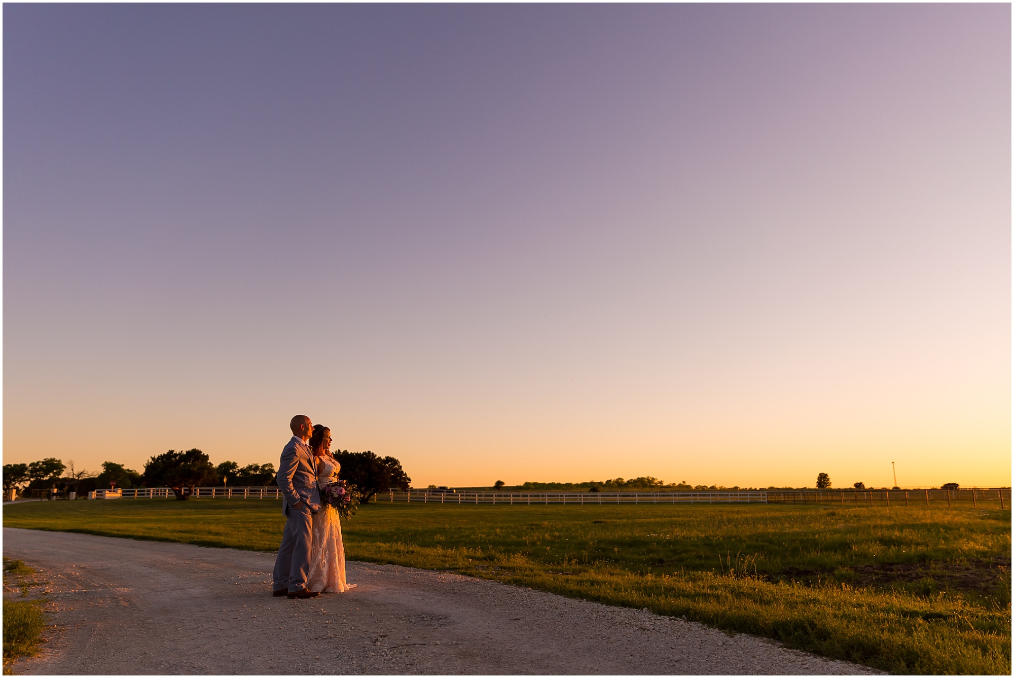 A bride and groom look out over a field as the sunsets in Waco, Texas | Jason & Melaina Photography | www.jasonandmelaina.com