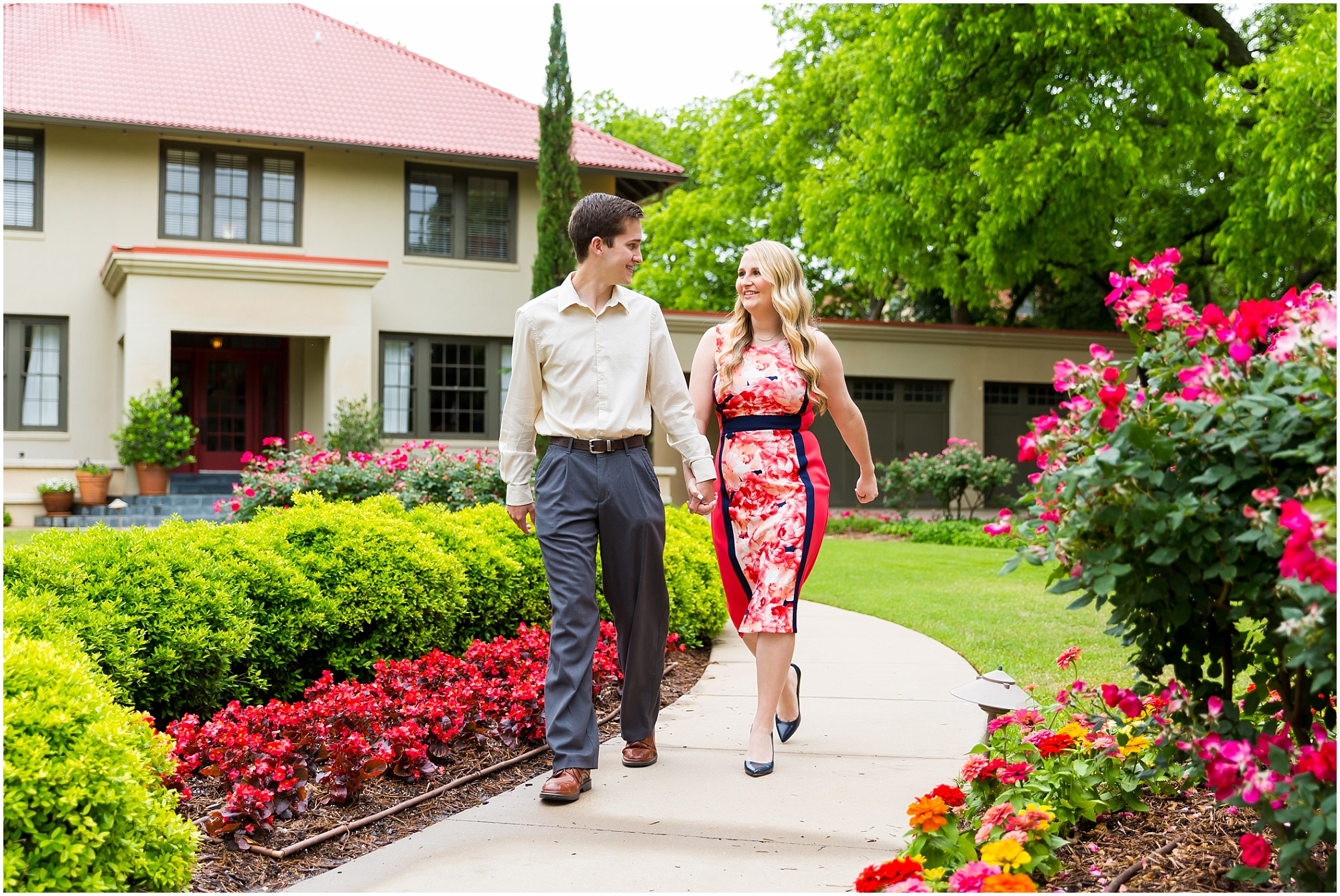 A couple strolls near the President's House on the Tarleton State campus during their engagement session - Jason & Melaina Photography - www.jasonandmelaina.com