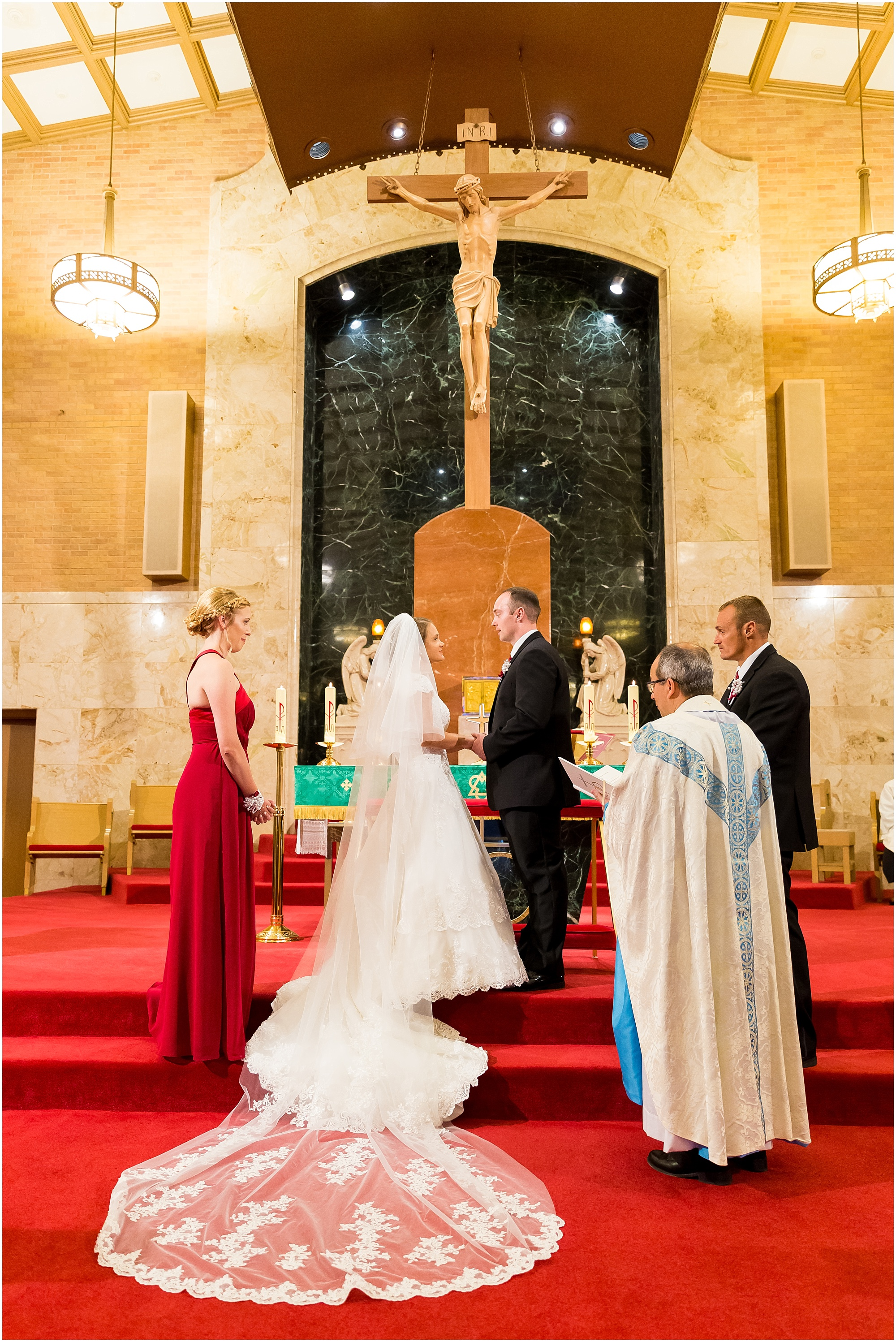 A couple exchanges vows inside St. Louis Catholic Church in Waco, Texas - Jason & Melaina Photography - www.jasonandmelaina.com