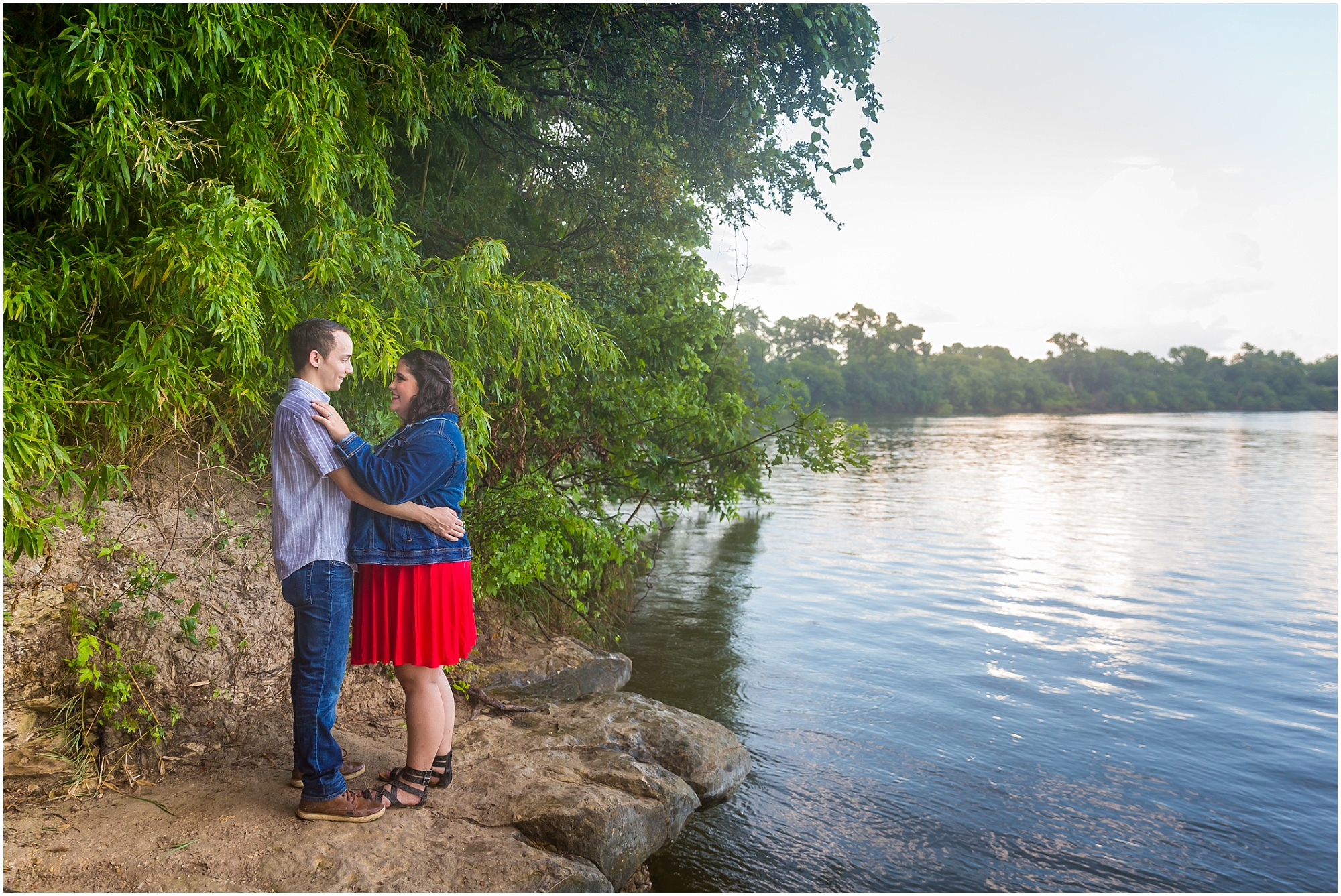 A couple embraces near Brazos River in Cameron Park in Waco, Texas during the engagement photos - Jason & Melaina Photography - www.jasonandmelaina.com