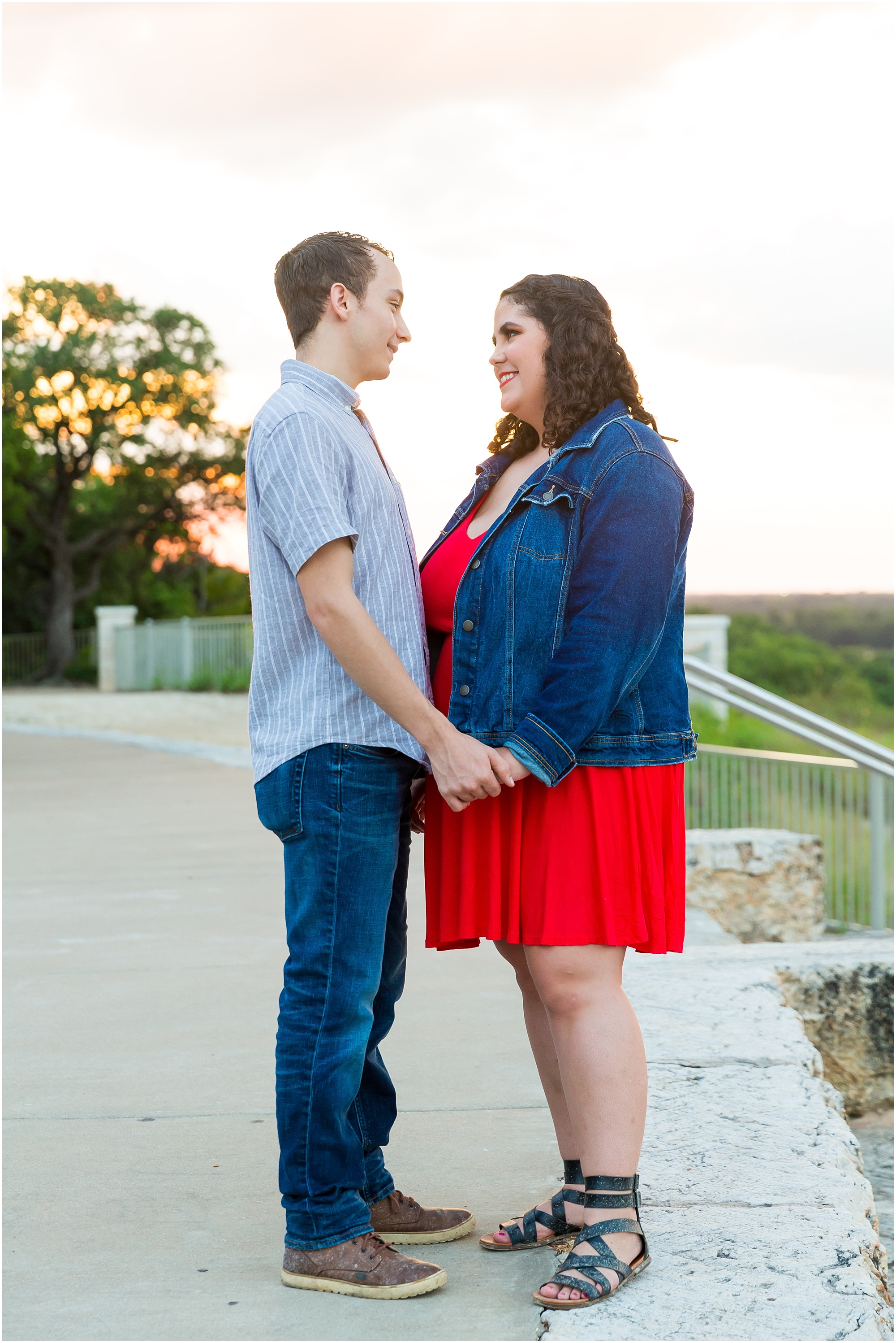A couple holds hands as the sun sets behind them - Jason & Melaina Photography - www.jasonandmelaina.com