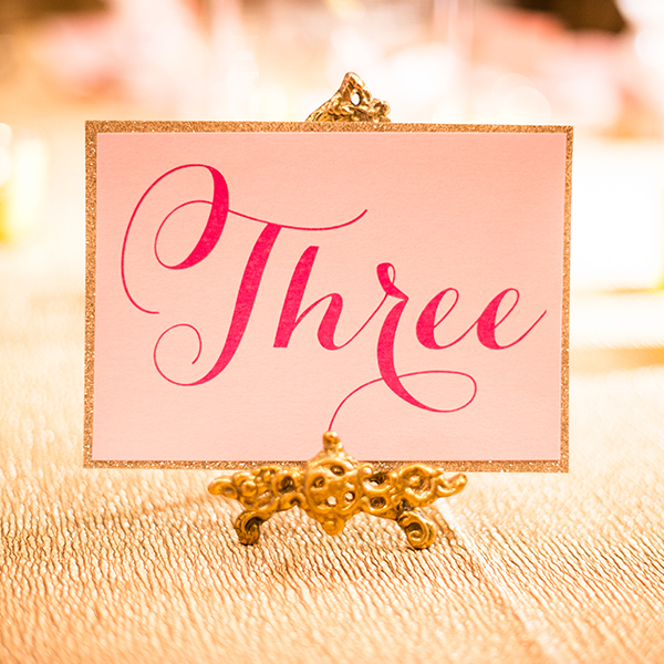 Pink Umbrella Designs - Table Number. Photo by Crista-Lee Photography
