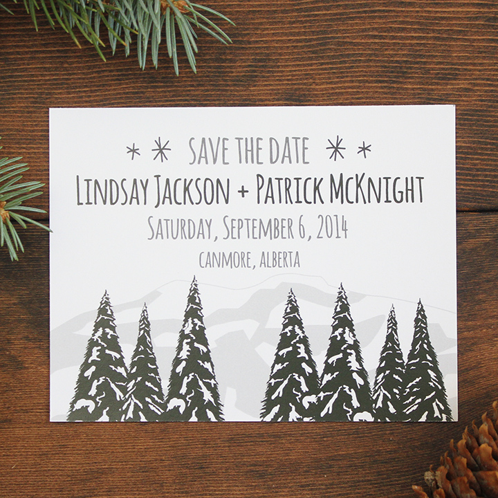Winter trees and mountains wedding save the date invite.