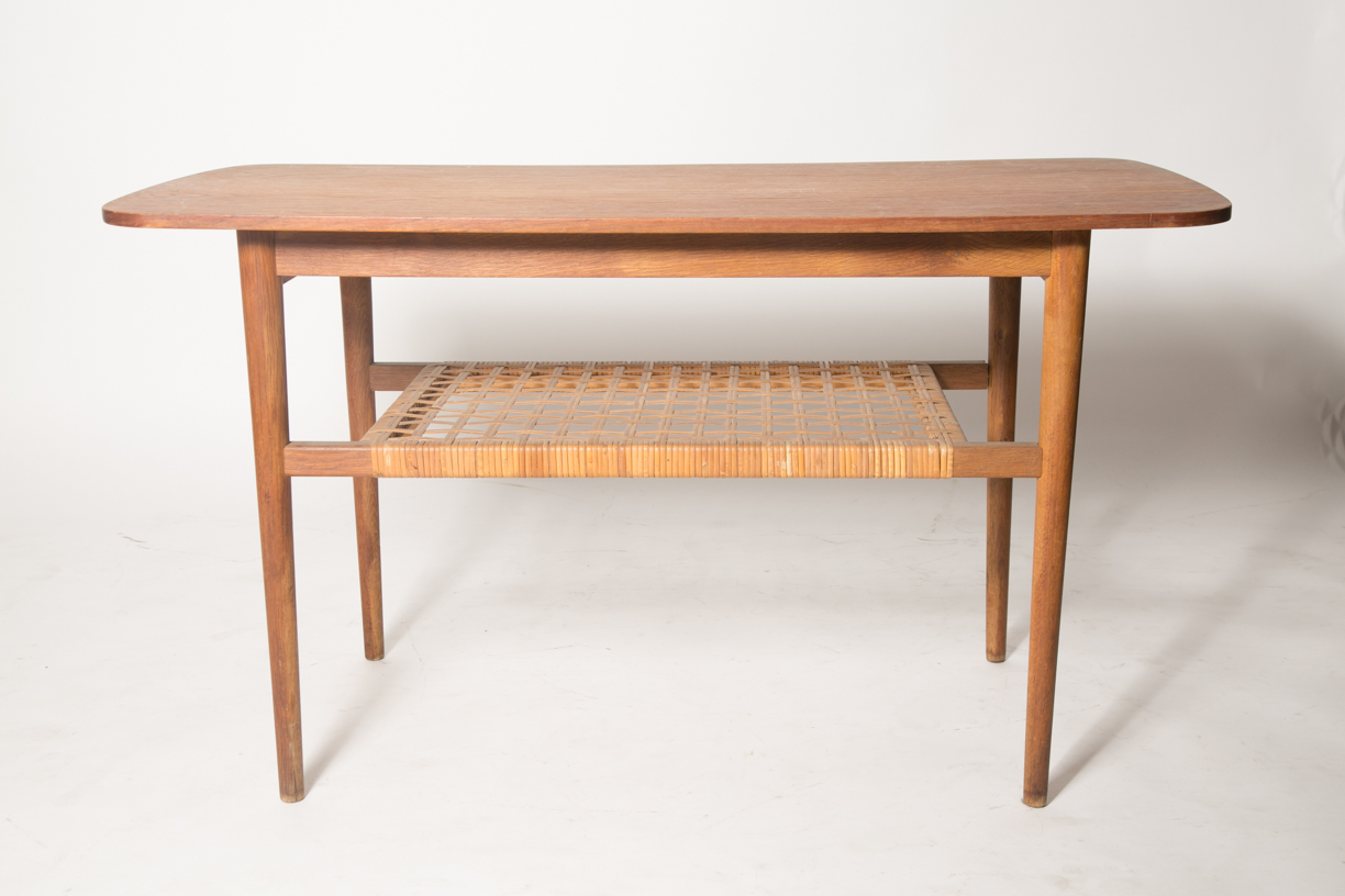 Compact console table with woven rack.jpg