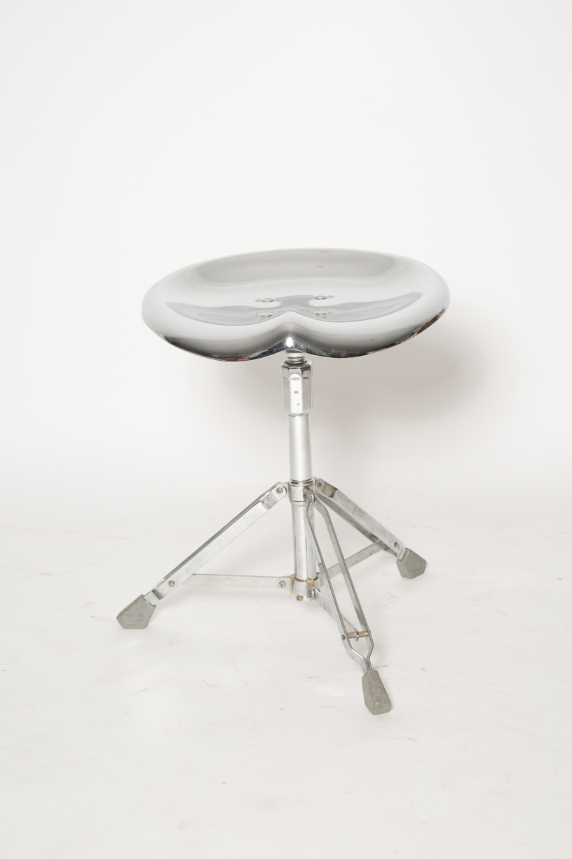 Yasuaki Sasamoto silver saddle stool chair.jpg