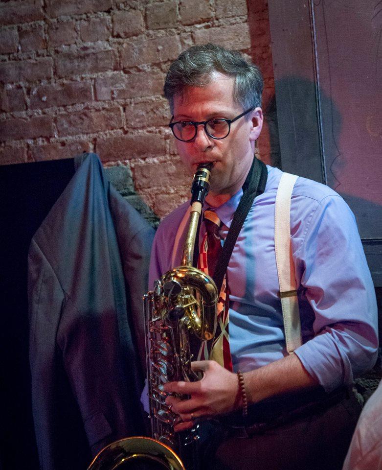 John B. on the baritone sax at Mona's, May 2019.