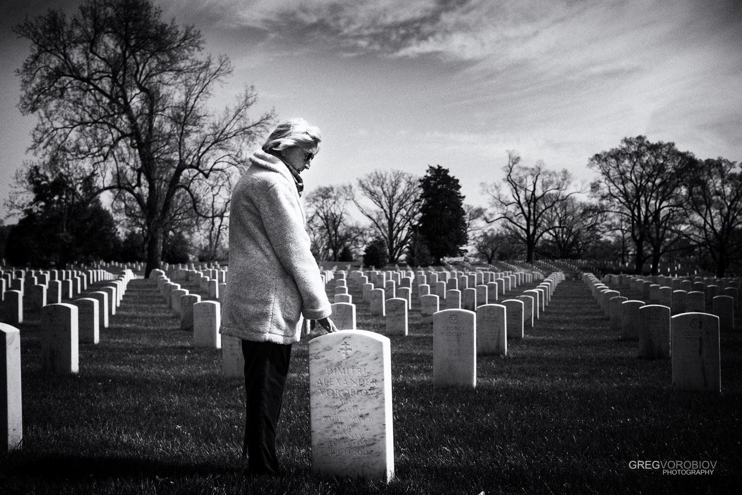 Anne, 90 year old widow graveside with her husband of nearly 60 years at Arlington Cemetery. She will be buried beside him.