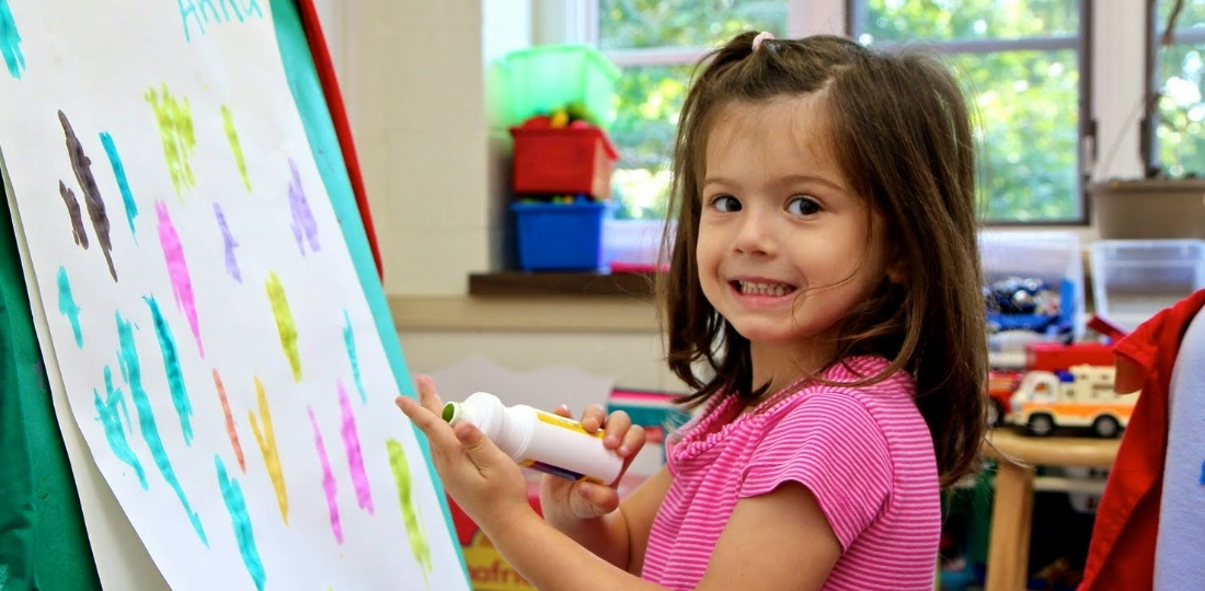 Preschool girl painting at CCEP