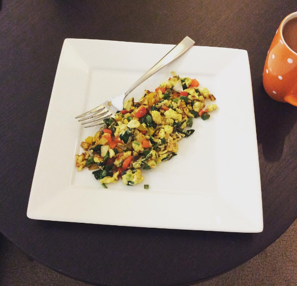 One of my favorite breakfasts to eat – scrambled eggs with cheese and vegetables.