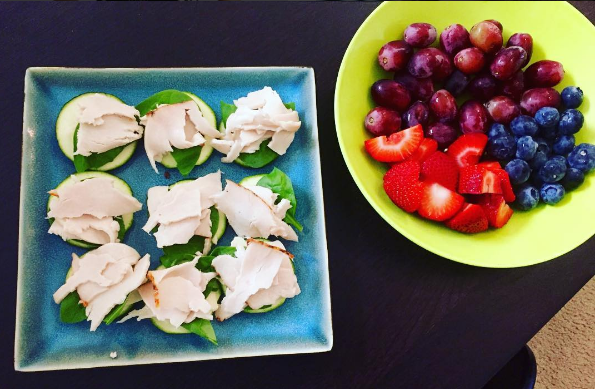 One of my lunches – zucchini slices topped with spinach, cheese, and turkey, and a side of fruit.