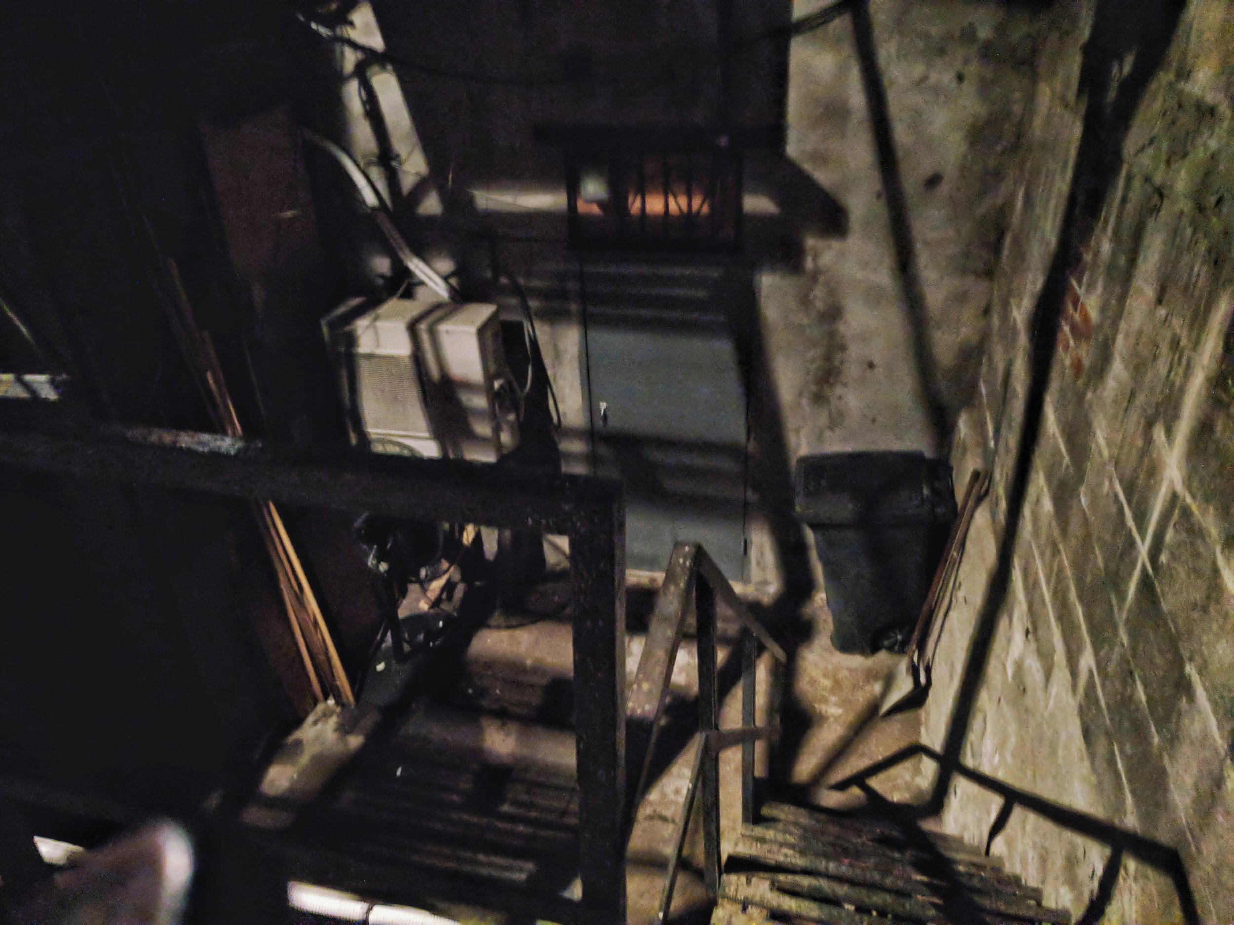 The stairs that lead you to an alleyway out of a horror movie