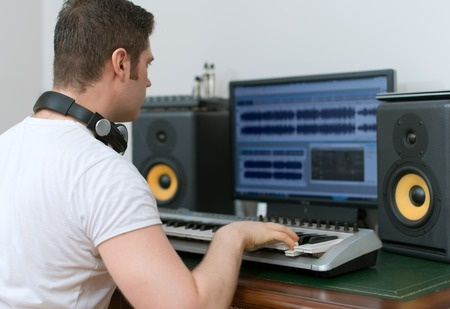 Music producer working in the studio.
