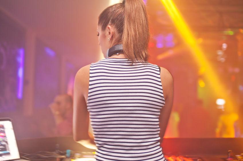 DJ girl in a nightclub mixing 848 Width x 565 Height