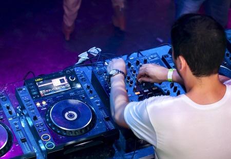 Dj mixes the track in the nightclub 450 Width x 310 Height.jpg