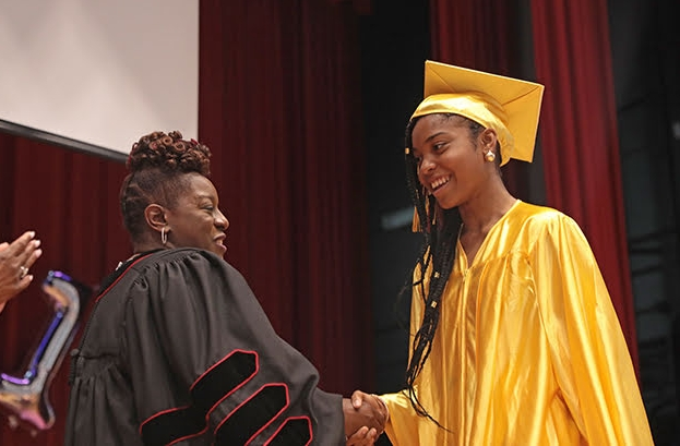 Dr. Lyle congratulates a student at the 2018 First Annual 8th Grade Graduation.