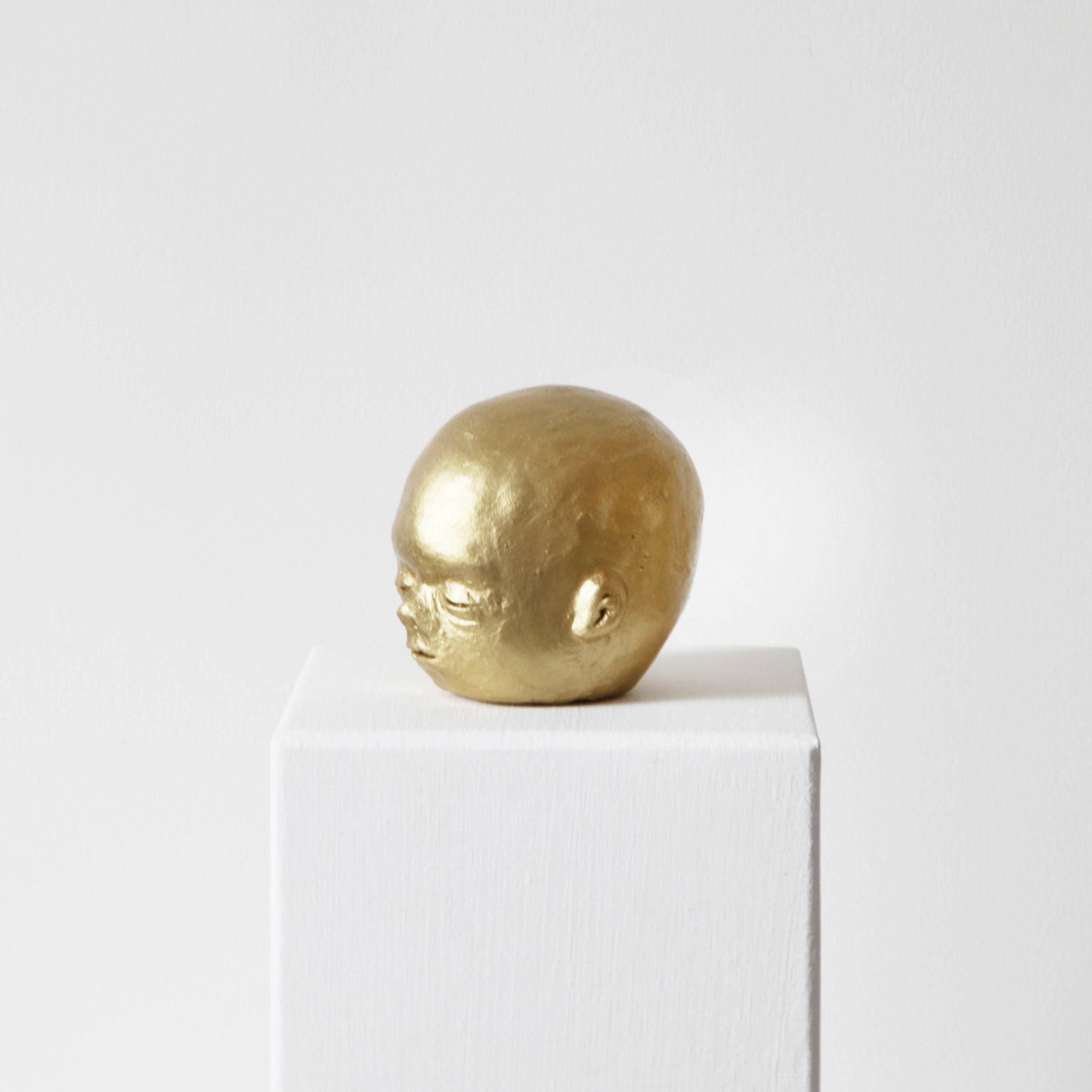 Facial development of the human embryo V  , 2017, raw clay, yellow gold pigment, lacquer and varnish, 8x7,2x8,3cm