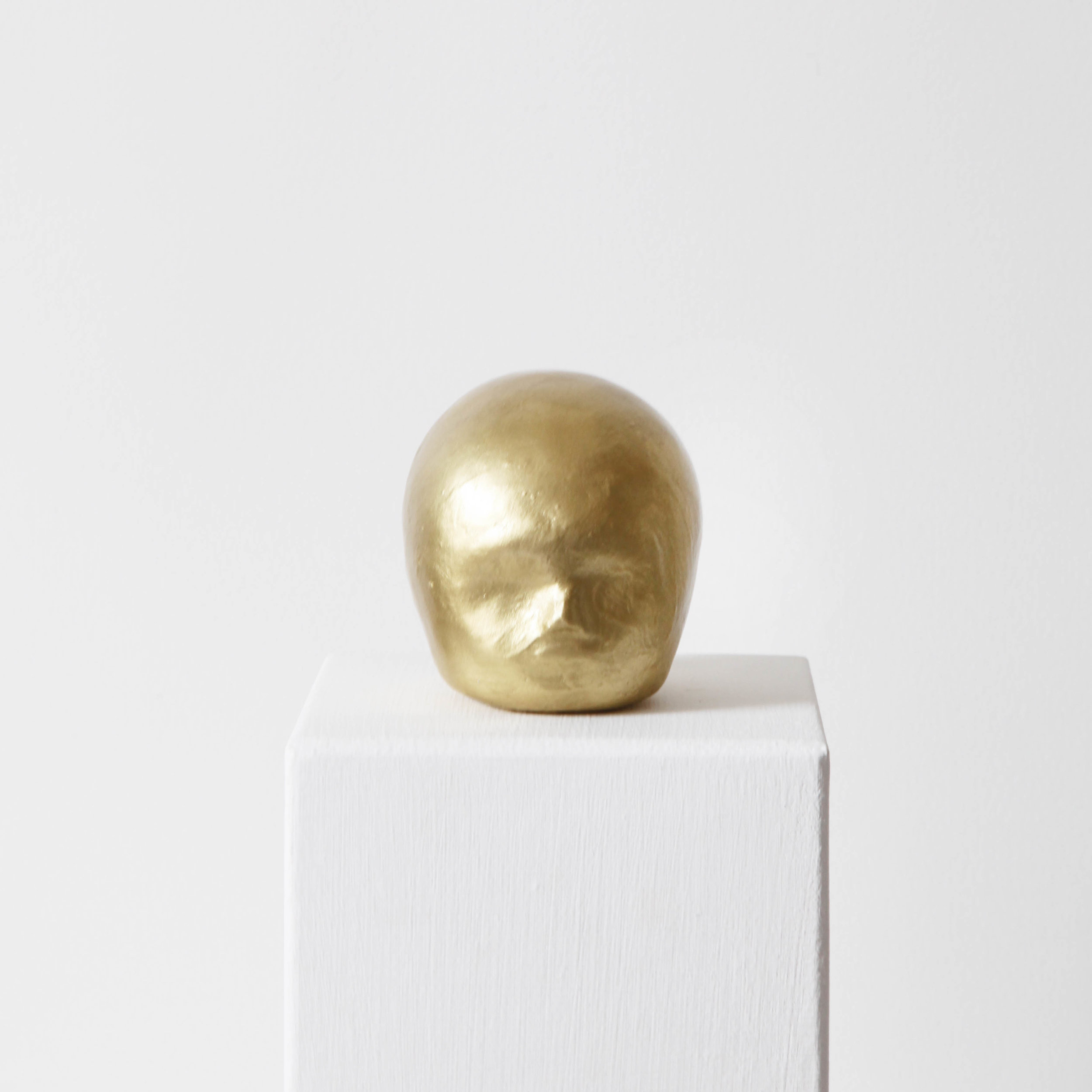 Facial development of the human embryo II  , 2017, raw clay, yellow gold pigment, lacquer and varnish, 8,6x7,4x8,8cm