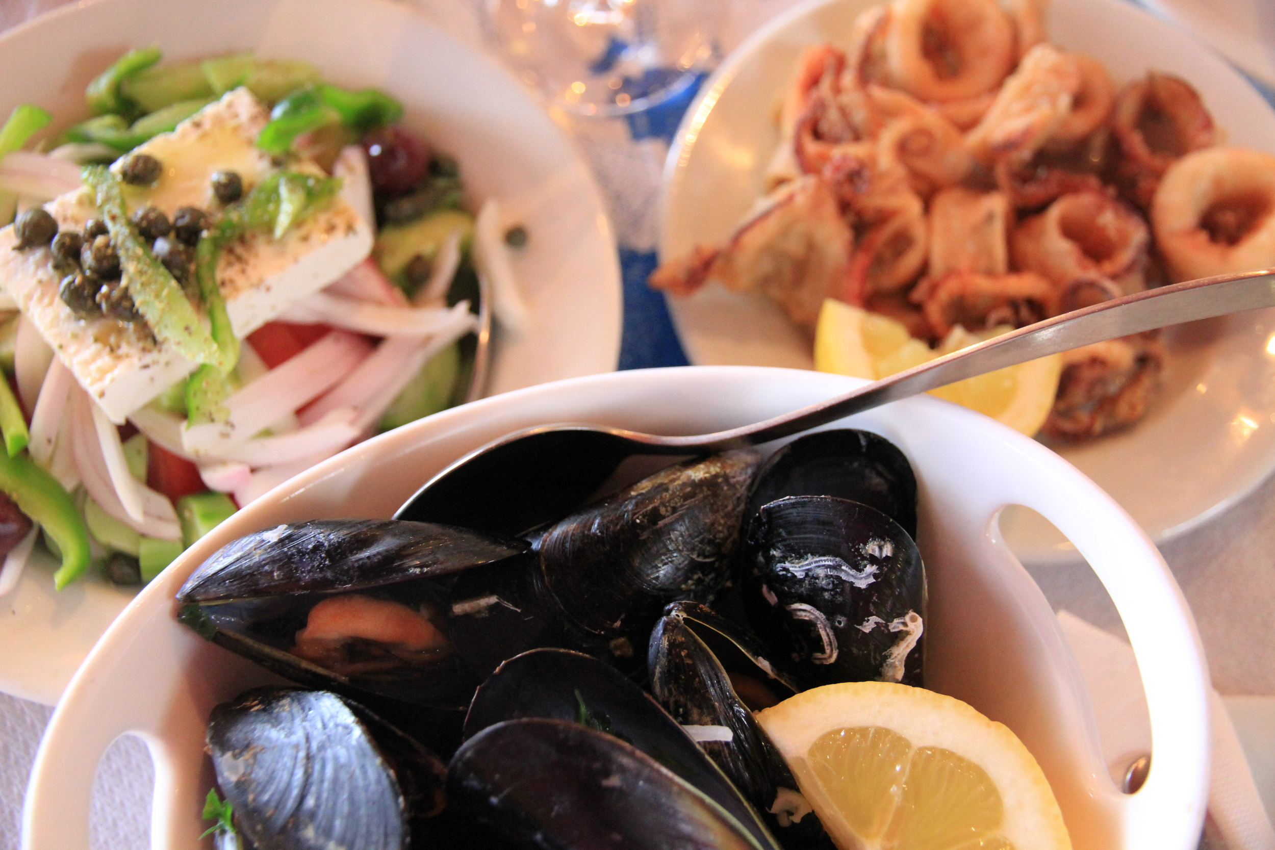 Amazing mussels and squid matched with a Greek salad - loaded with healthy fats and full of goodness