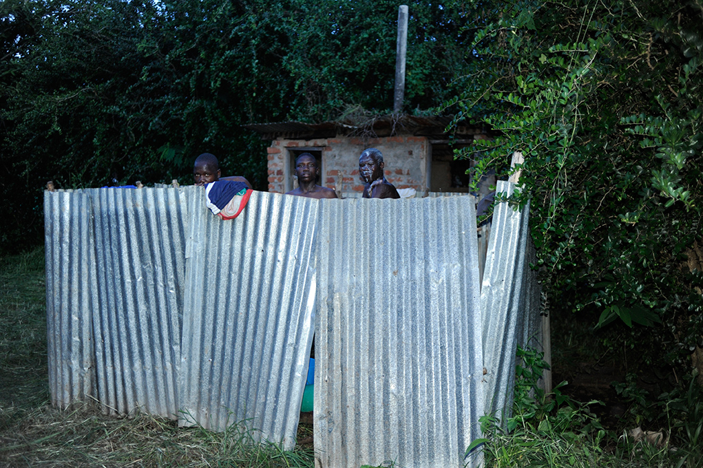 Old iron sheets from demolished poultry house create privacy for the boys showers
