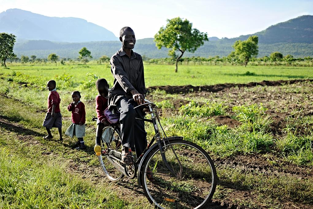 Teacher,Omukat Godfrey Mackay, Namalu School, bringing his son to Kaawach Nursery in the morning.