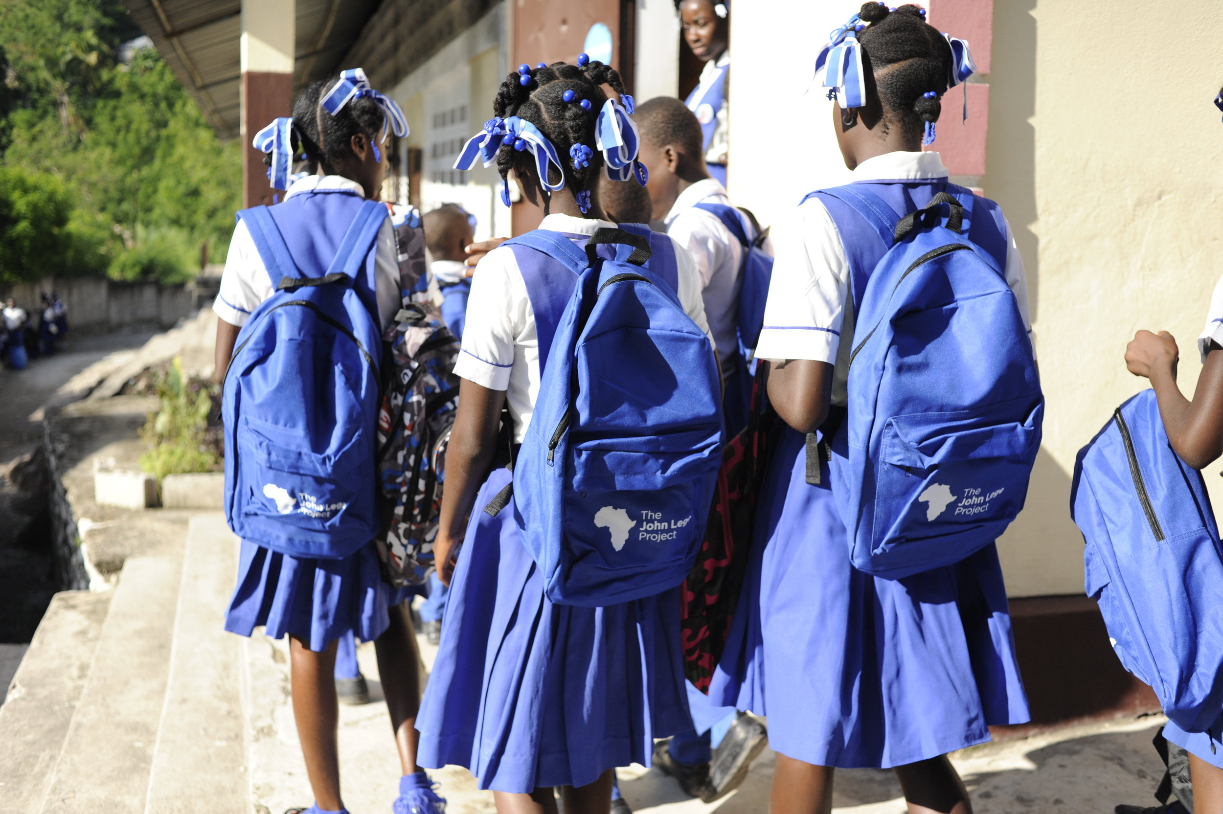 Off to school happier than before; backpacks matched their school uniforms!!!!