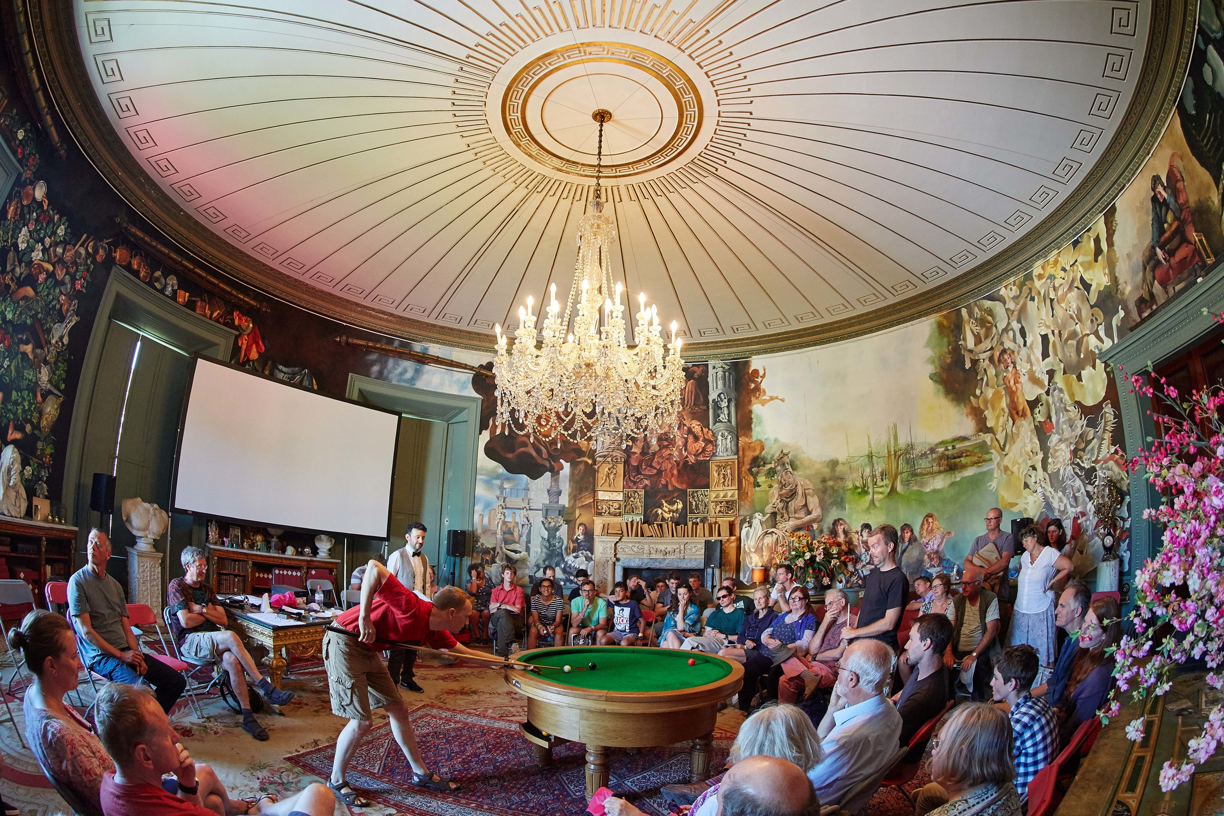 The tournament was held in the Round Room at Port Eliot, Cornwall, on July 31 and August 1, 2015. The room,  designed in 1804 by Sir John Soane, is one of the architectural highlightsof Port Eliot. British artist Robert Lenkiewicz spent30 years on and off painting the mural and it is considered his masterpiece. With so muchBritisharchitectural and artistic heritage in the room it seemed the perfect venue to make sporting history with the launch of LOOP. The pocket was positioned directly underneath the centre of the chandelier. Picture: Michael Bowles.