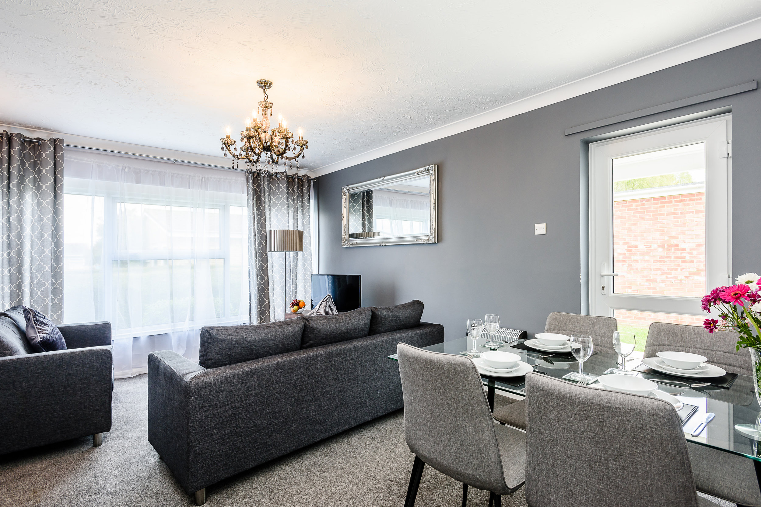 Above: A holiday villa for the modern day staycation - with recent investment in recent interior and exterior refurbishments at Tingdene Broadlands Park & Marina.