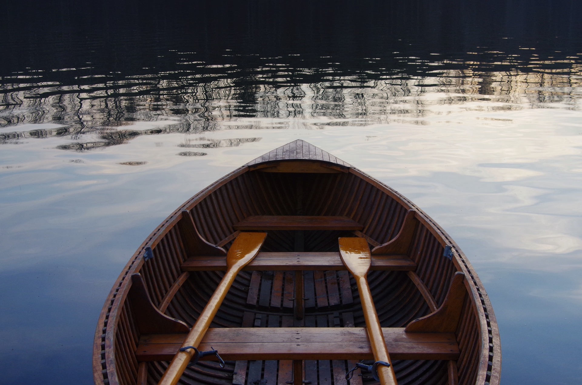 A traditional rowing boat on the water.