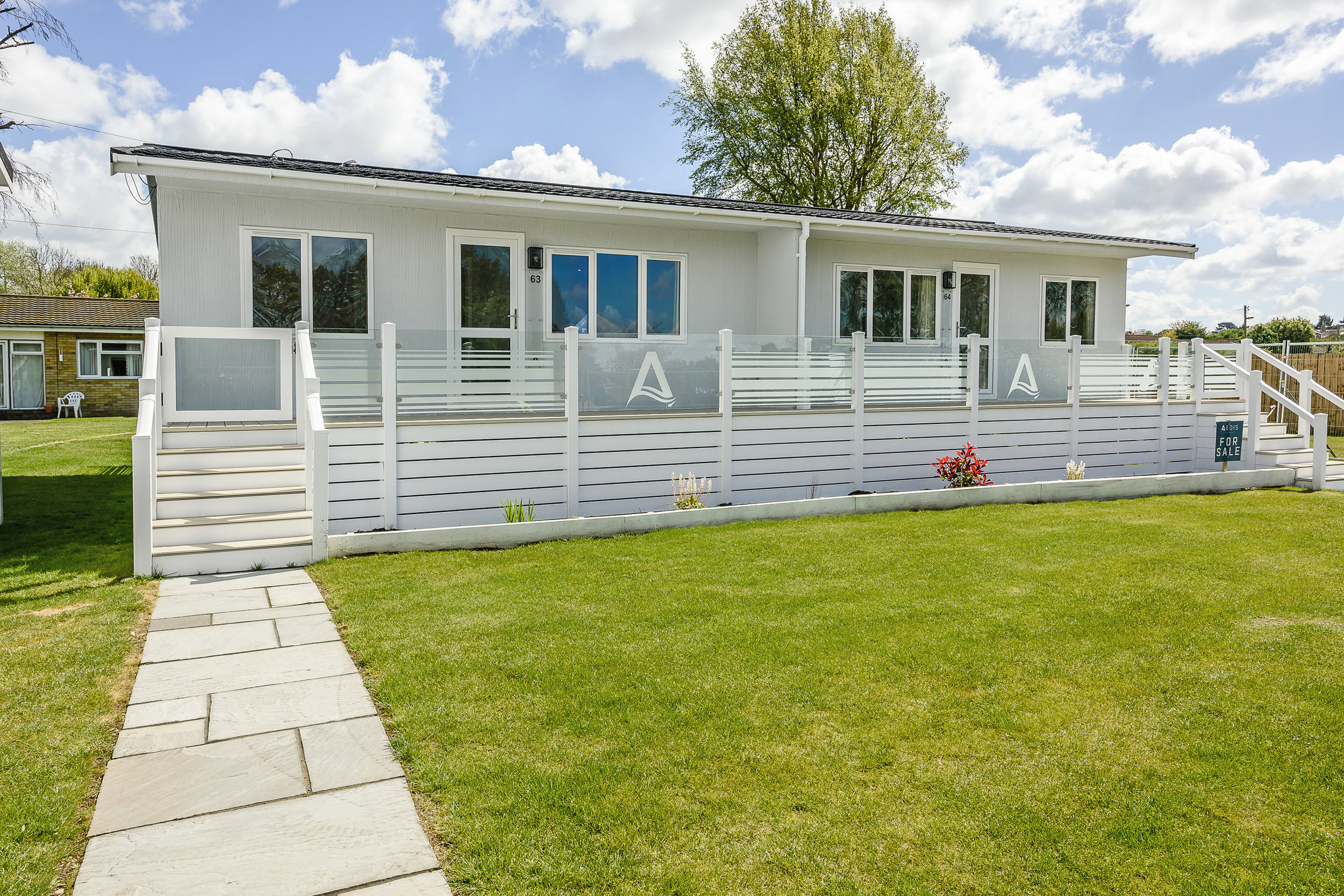 Image: A new holiday property with 2 bedrooms, luxury decking, unrivalled views of the Broads National Park and a 125 year lease to boot - all round a sound investment.