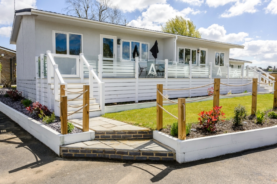 Image: an example of a contemporary holiday property at Tingdene Broadlands Parks & Marina, in Oulton Broad, Suffolk, one of the many holiday/lifestyle offerings available from Tingdene locally.